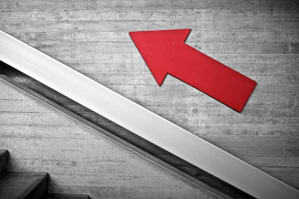 an arrow showing an upward trend.