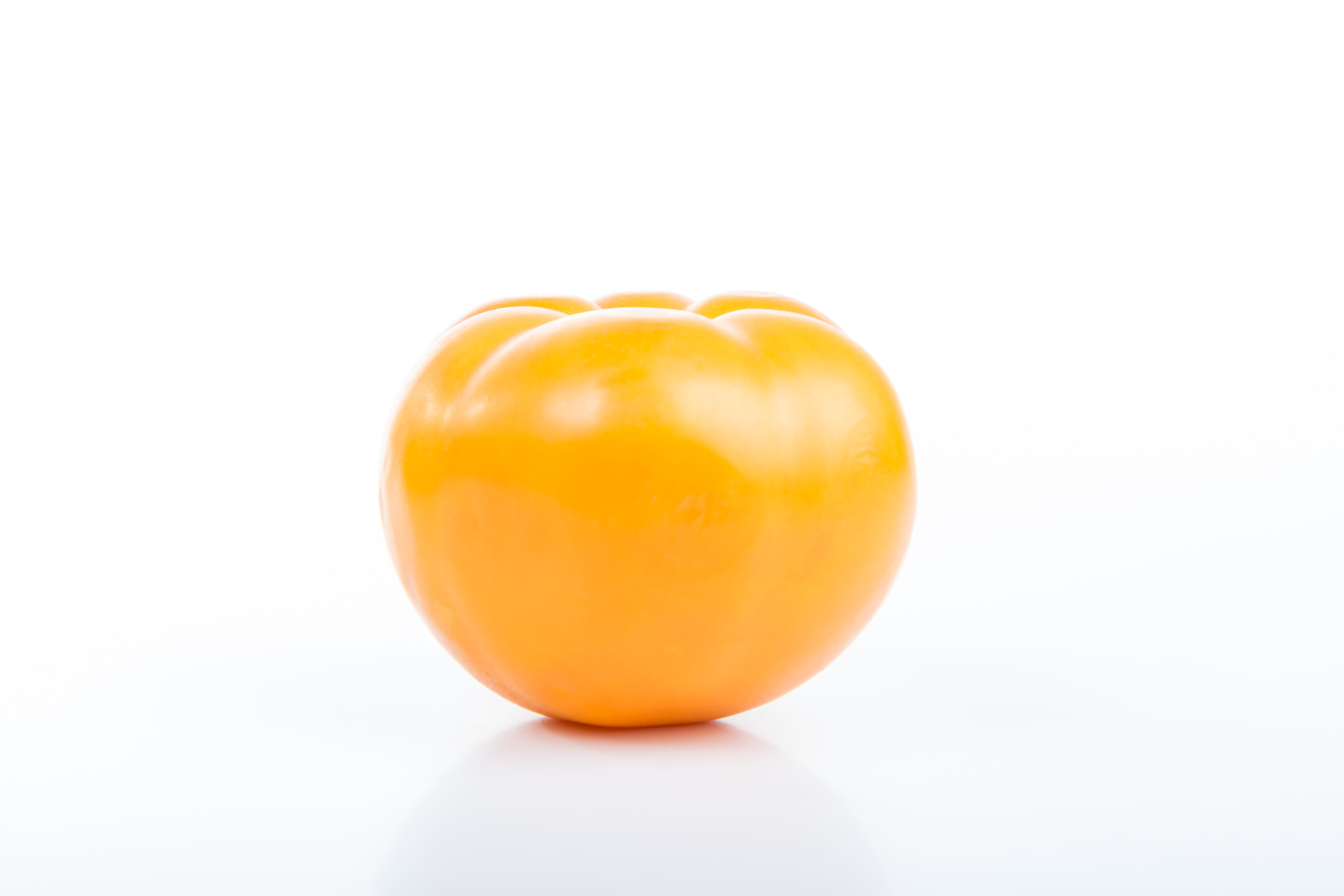 tomato on top of white surface