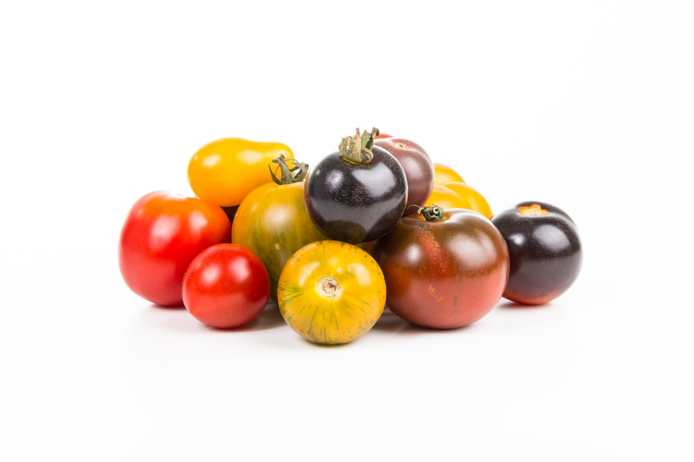 round fruits on white surface