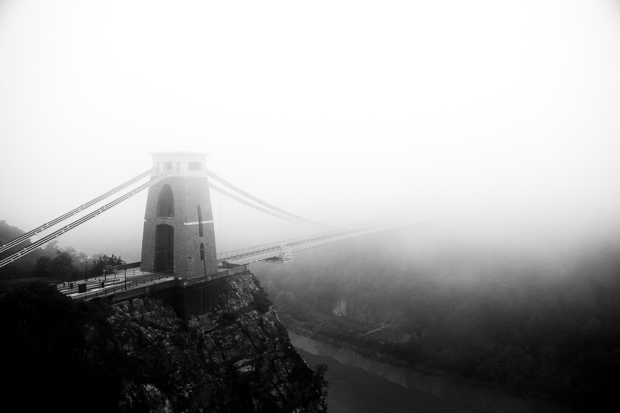 I had waited patiently for months to get this shot. Checking the weather forecast on a daily basis as we approached autumn for a foggy morning. Finally on this early chilly morning (07h00) the fog was thick enough to submerge the opposite side of the bridge creating a mystique - where does the bridge go?  The bridge is an awe inspiring landmark of Bristol. It was the brainchild of Isambard Kingdom Brunel back in around 1830, but the build was halted by the Bristol Riots. The bridge was finally completed in 1864, after Brunel's death.