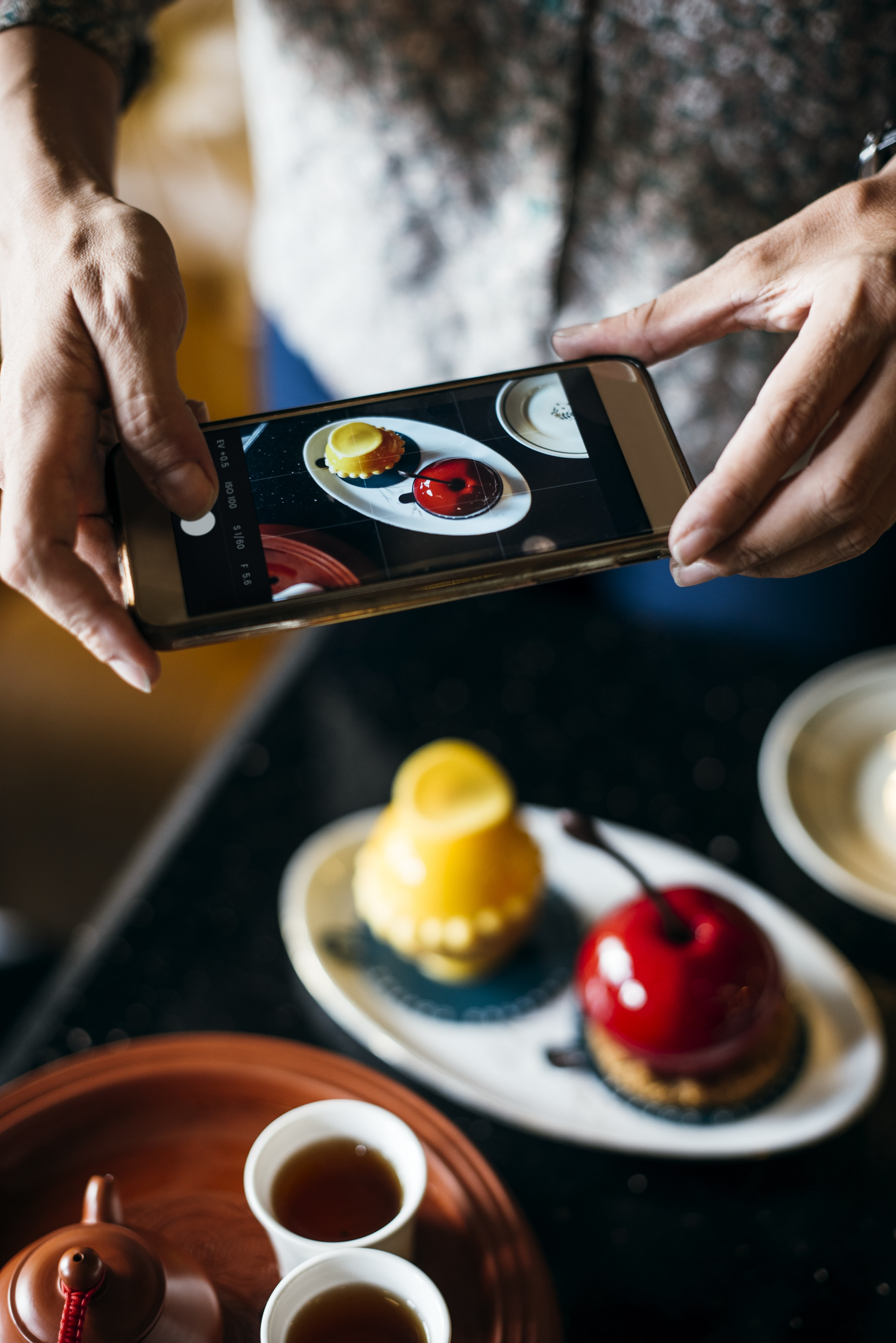 person taking photo of food