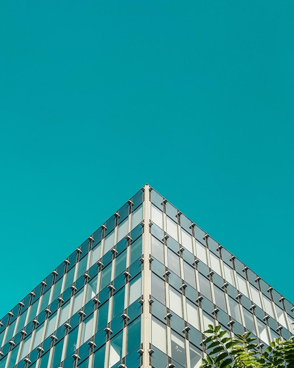 gray concrete building under teal sky