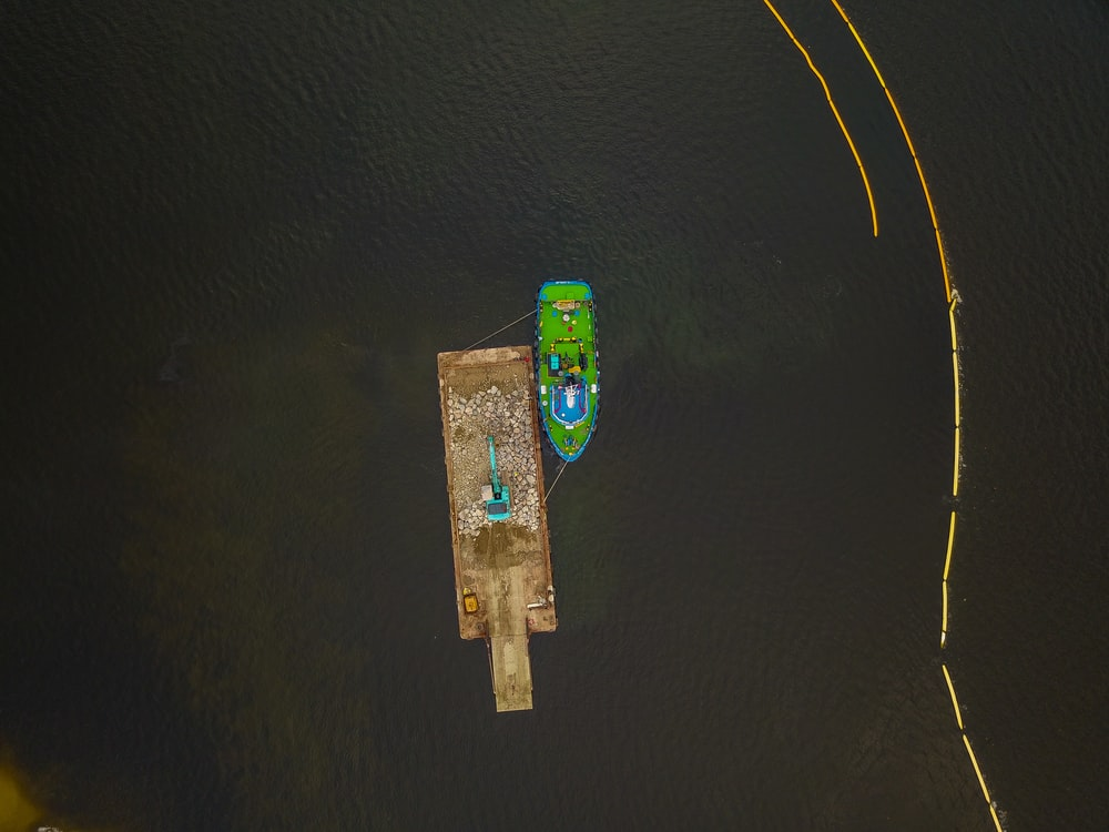 areal photography of green boat on body of water