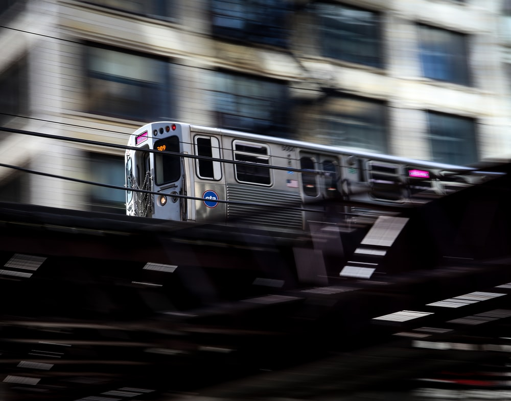 timelapse photography of gray train