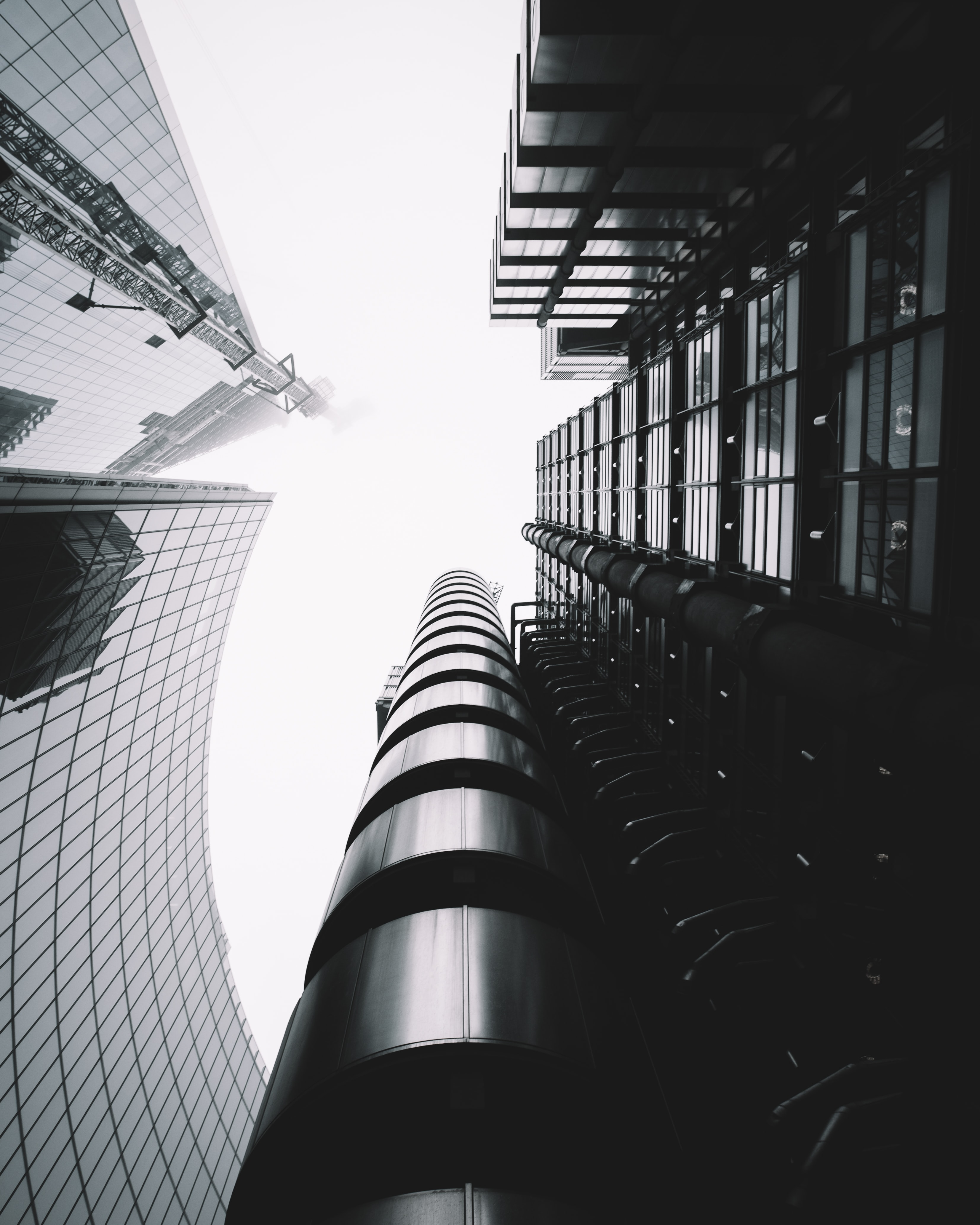 low-angle photography of skycraper buildings