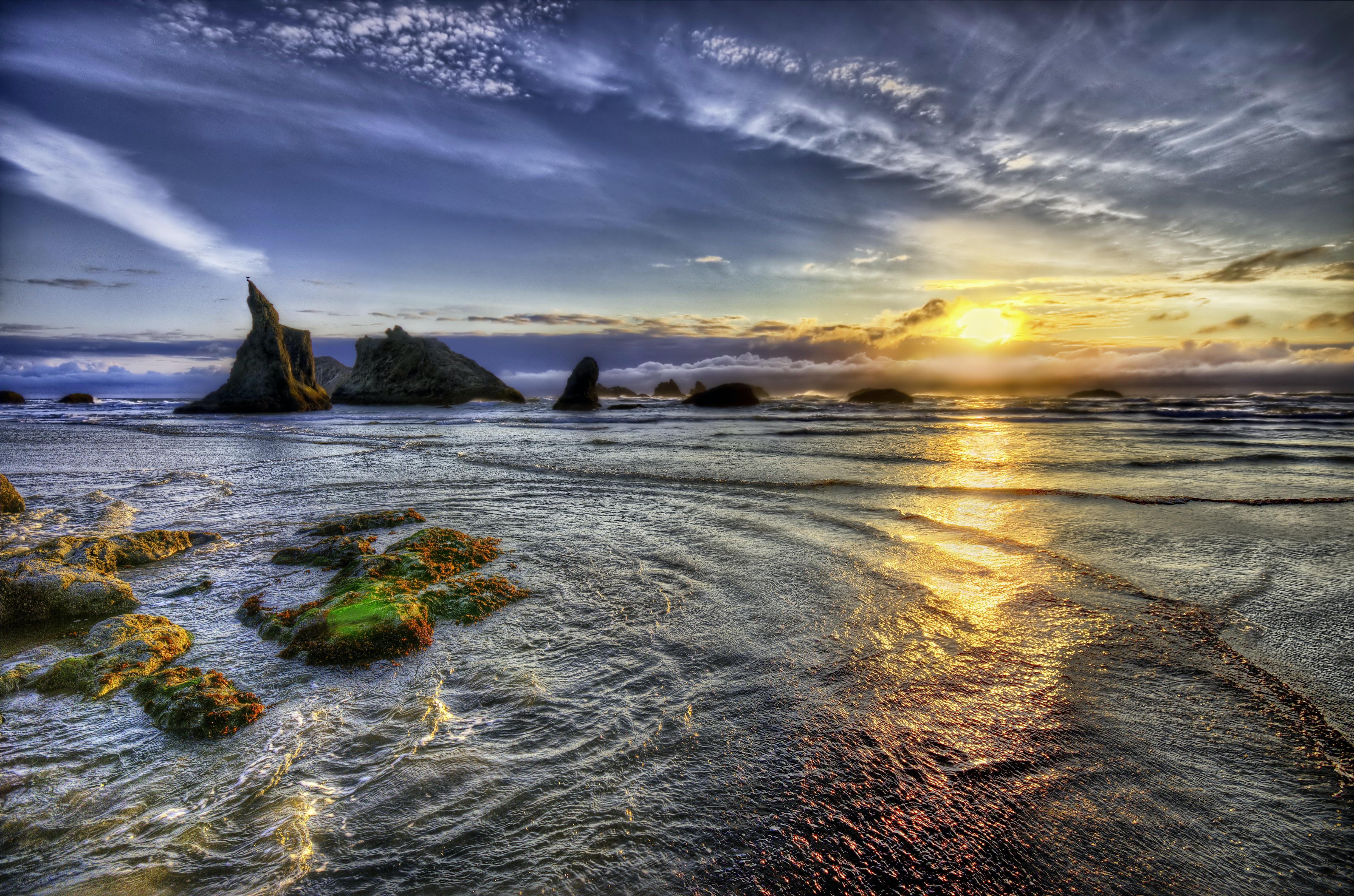 landscape photo of ocean during golden hour