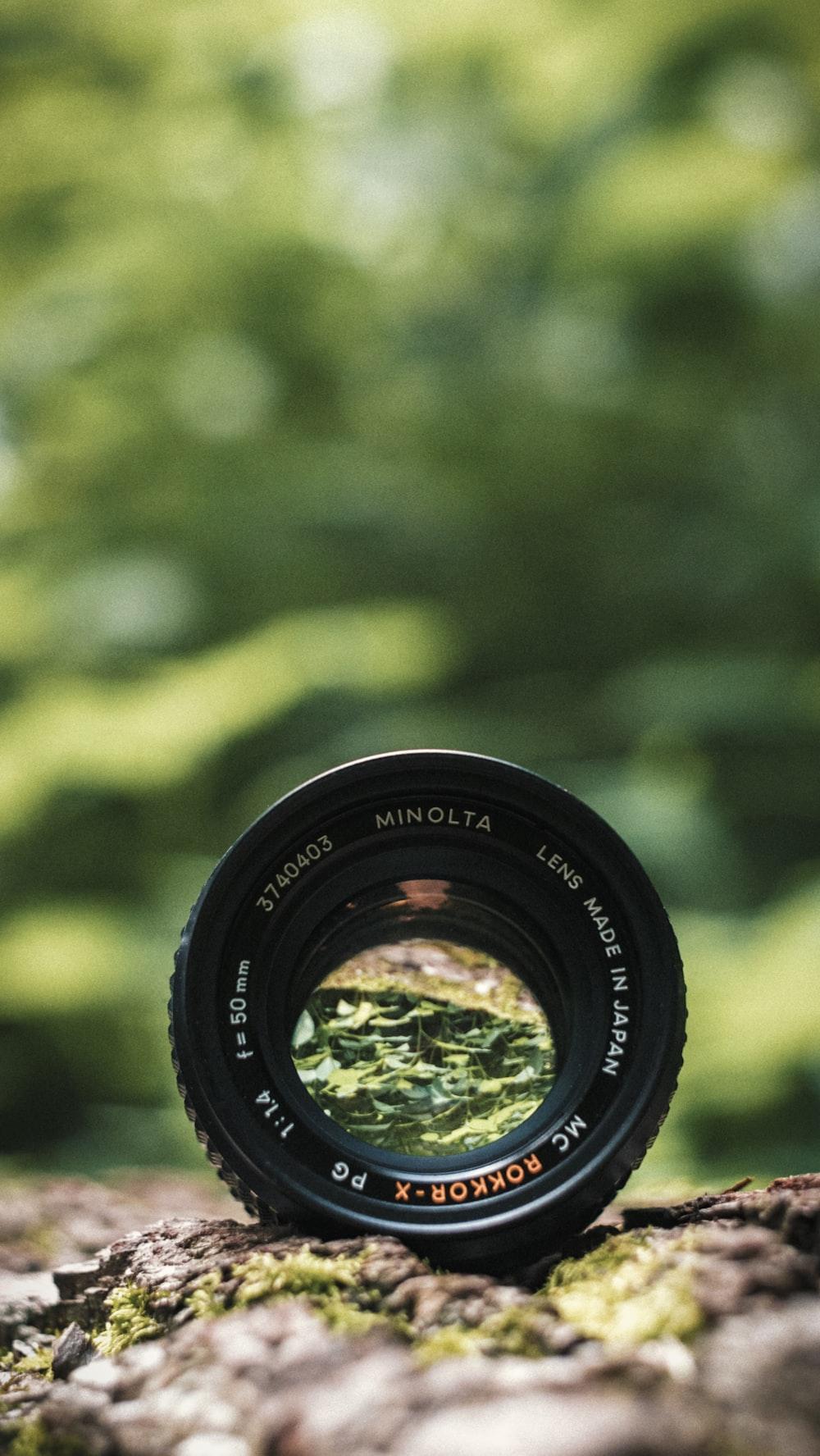 black Minolta lens in selective focus photography
