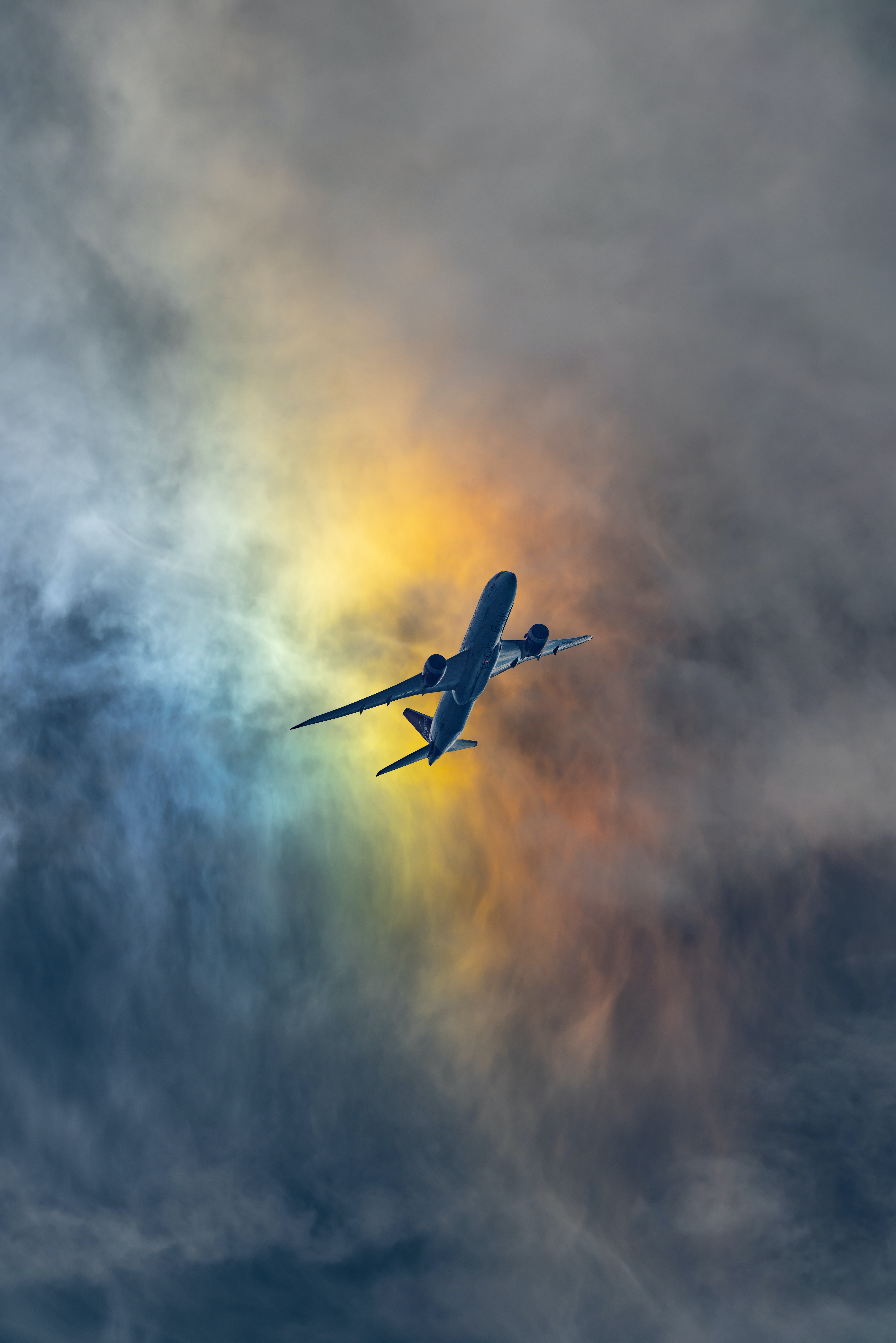 photo of white airplane under cloudy sky