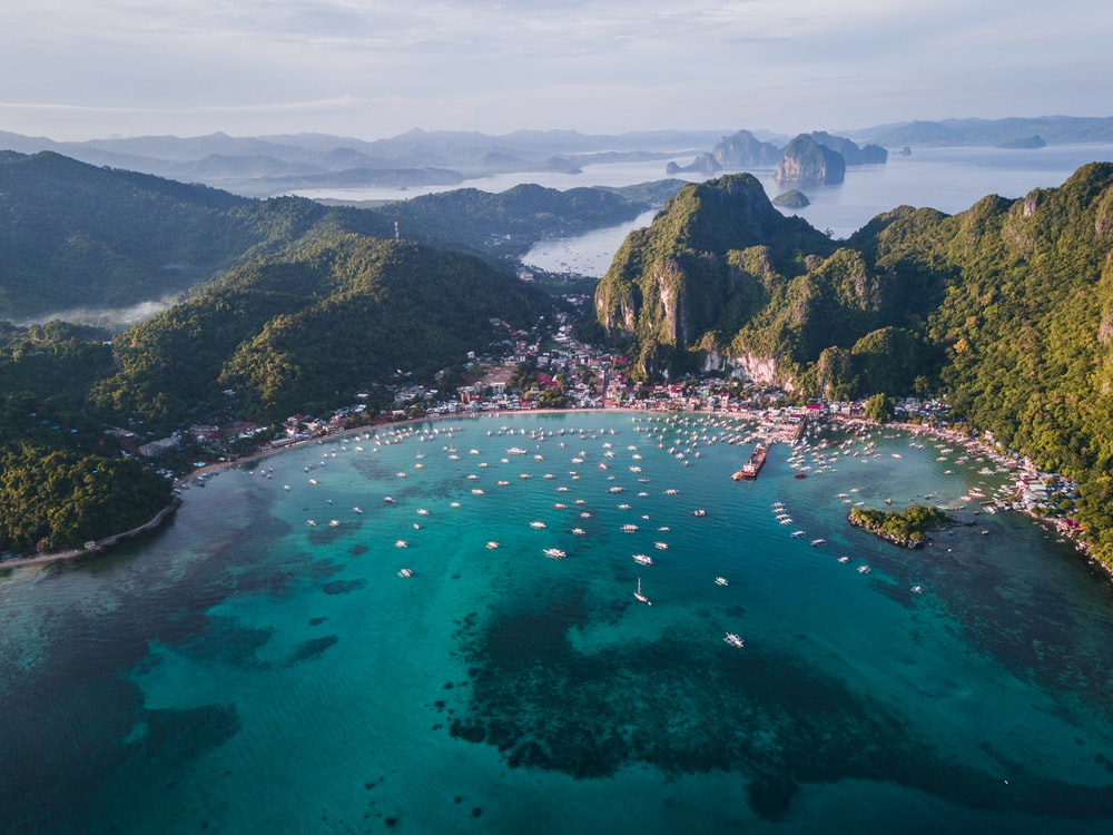 landscape photography of island with boats