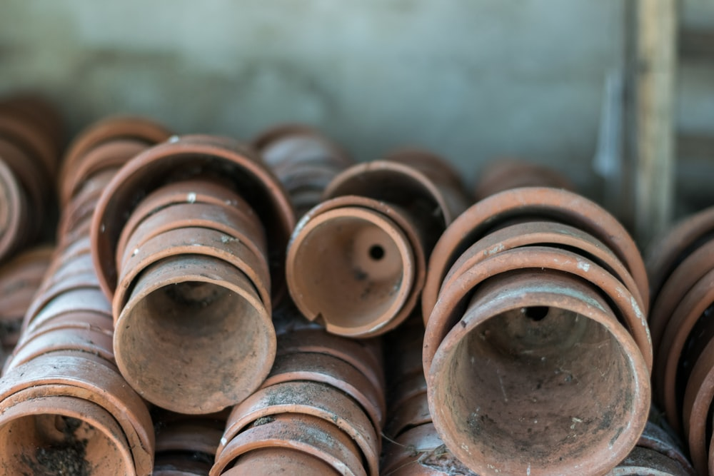shallow focus photography of brown plant pot lot