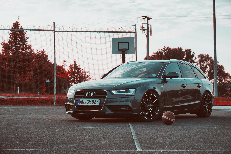black Audi car on basketball court