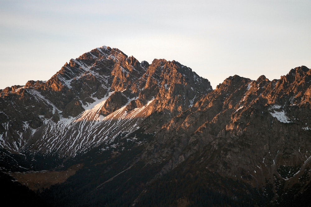 landscape photography of brown and white mountains