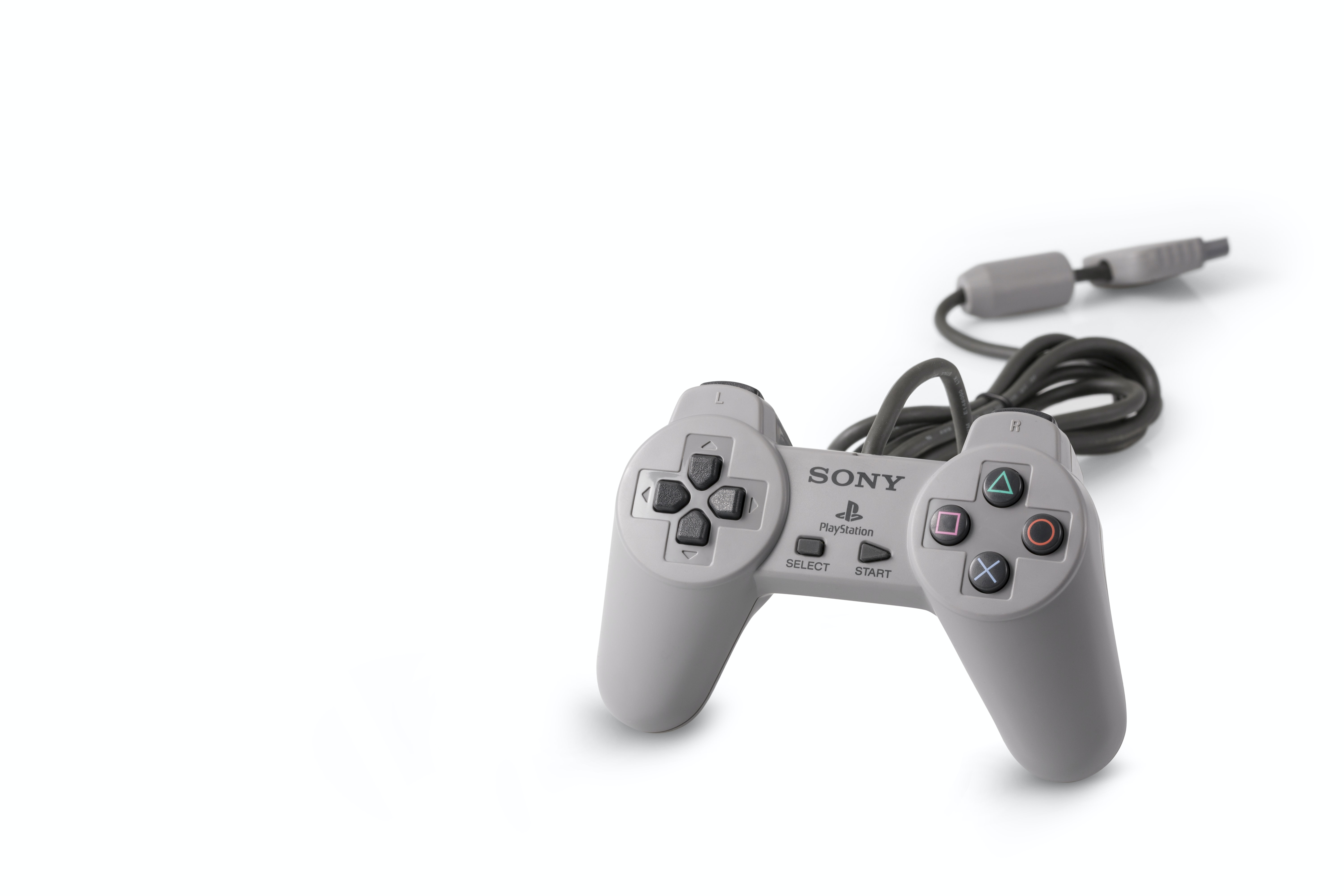 gray Sony Playstation game pad