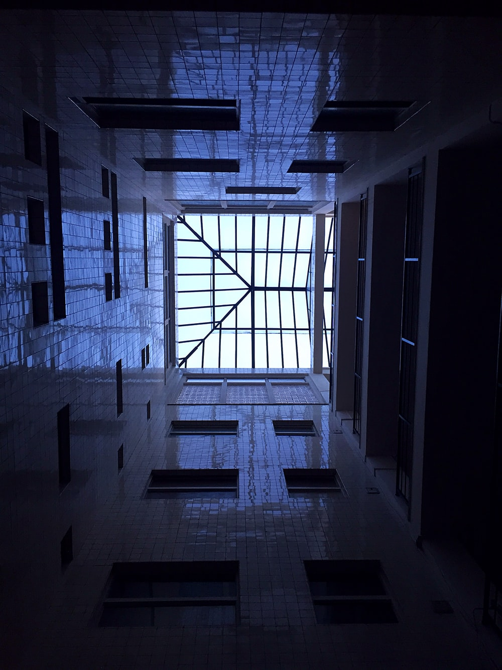 low-angle photography of white interior building