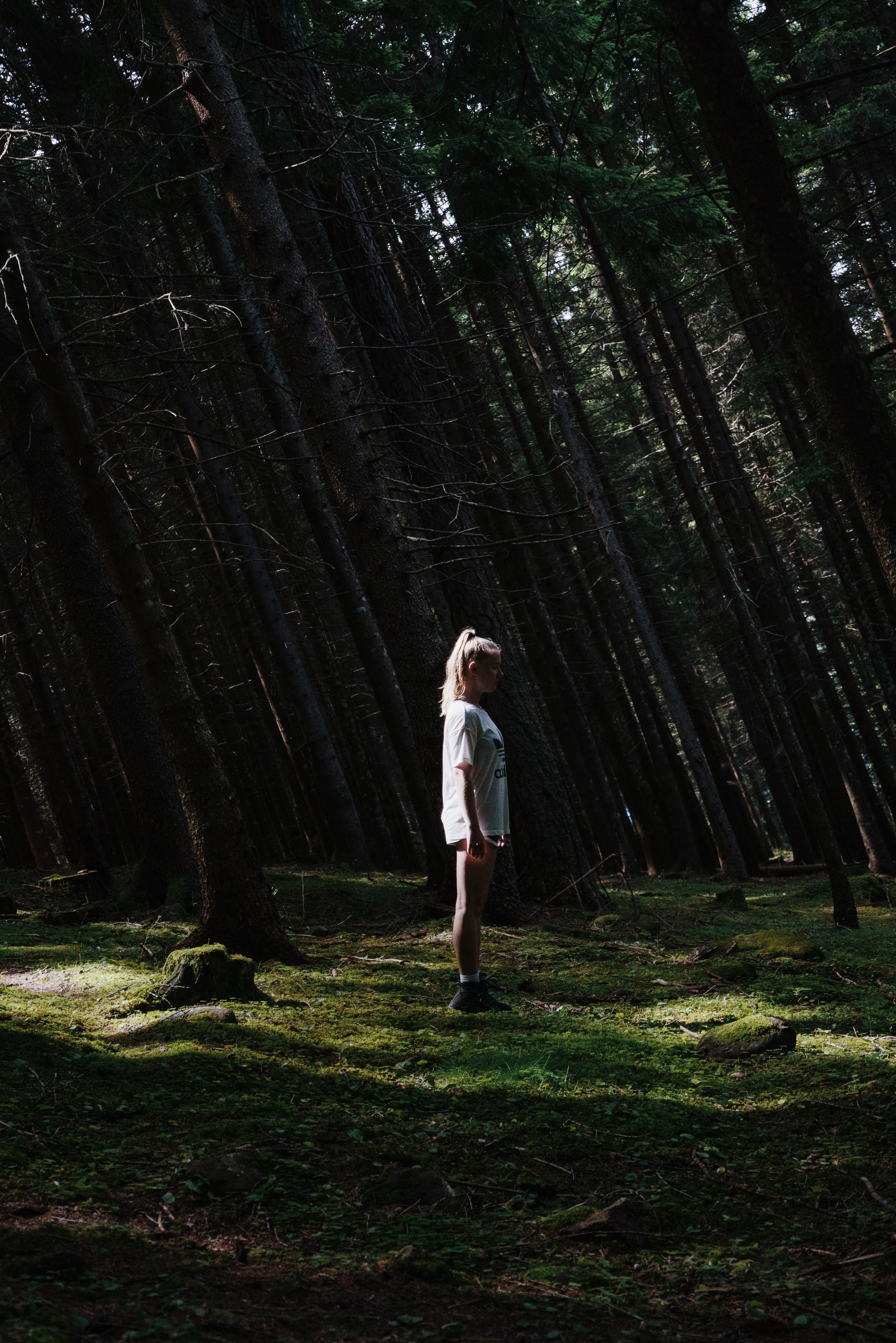woman standing on forest