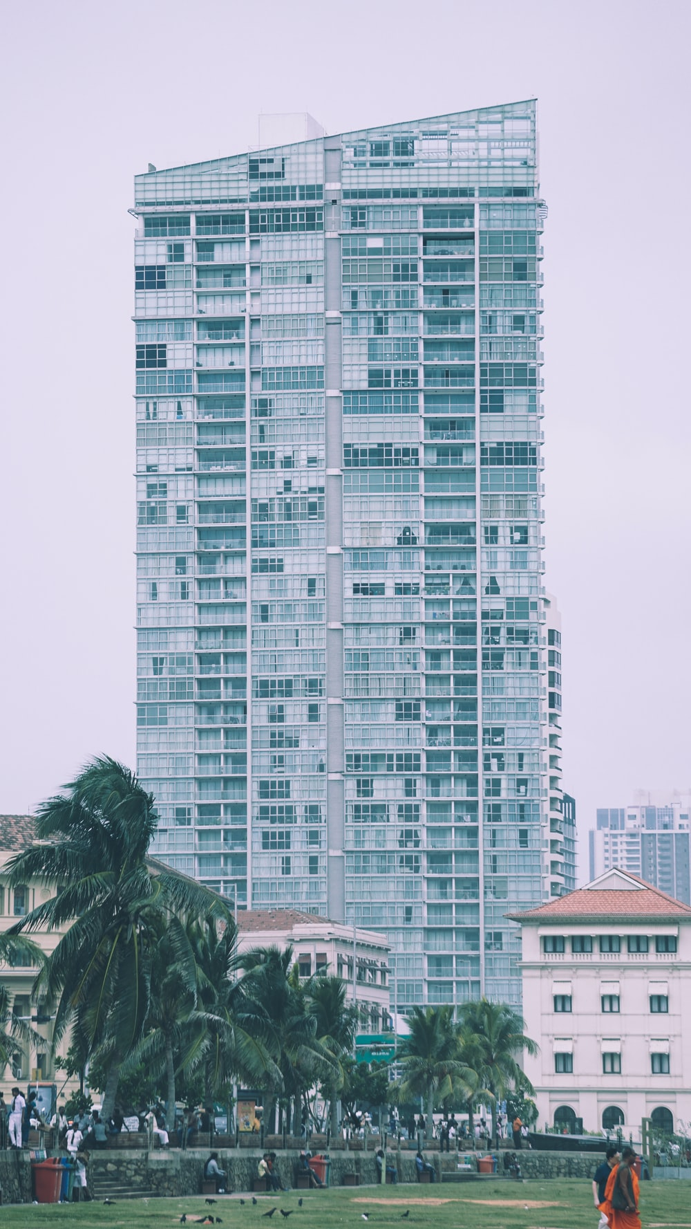 low angle photo of gray high-rise building