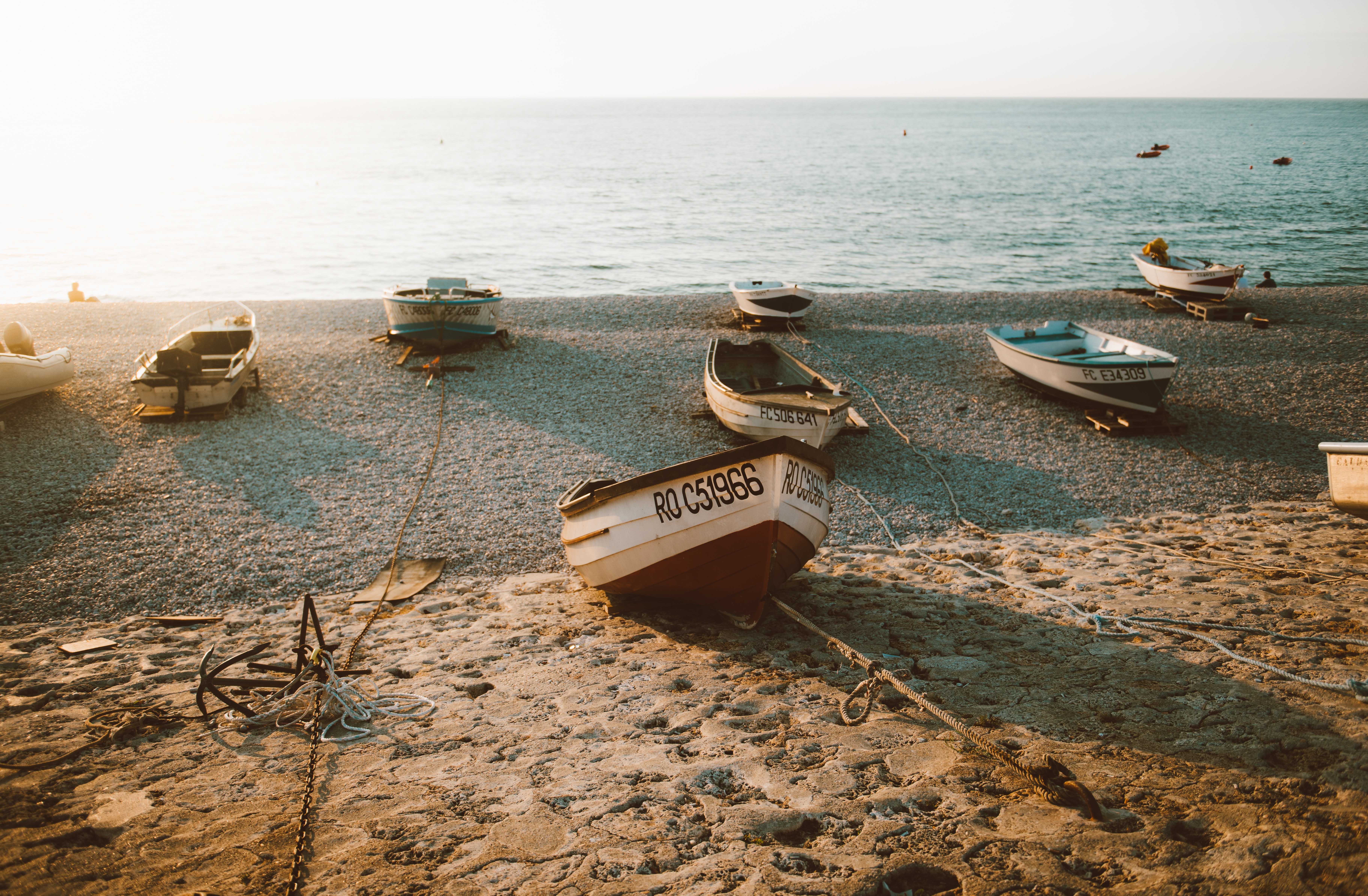 boats placed on shoreline