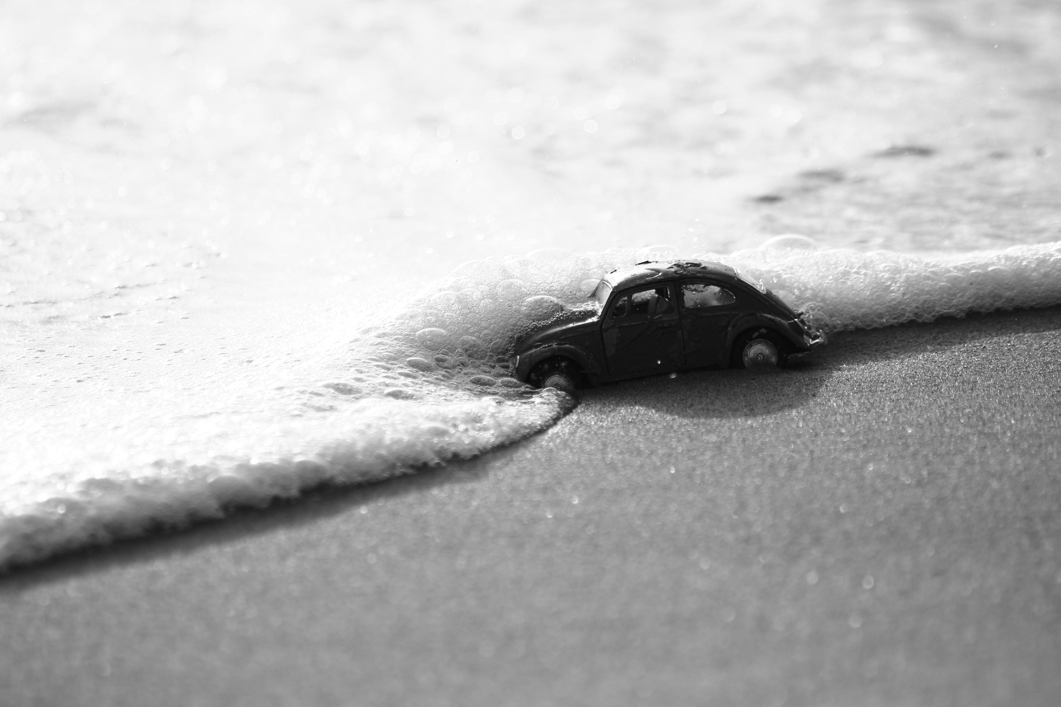 grayscale photo of Volkswagen beetle
