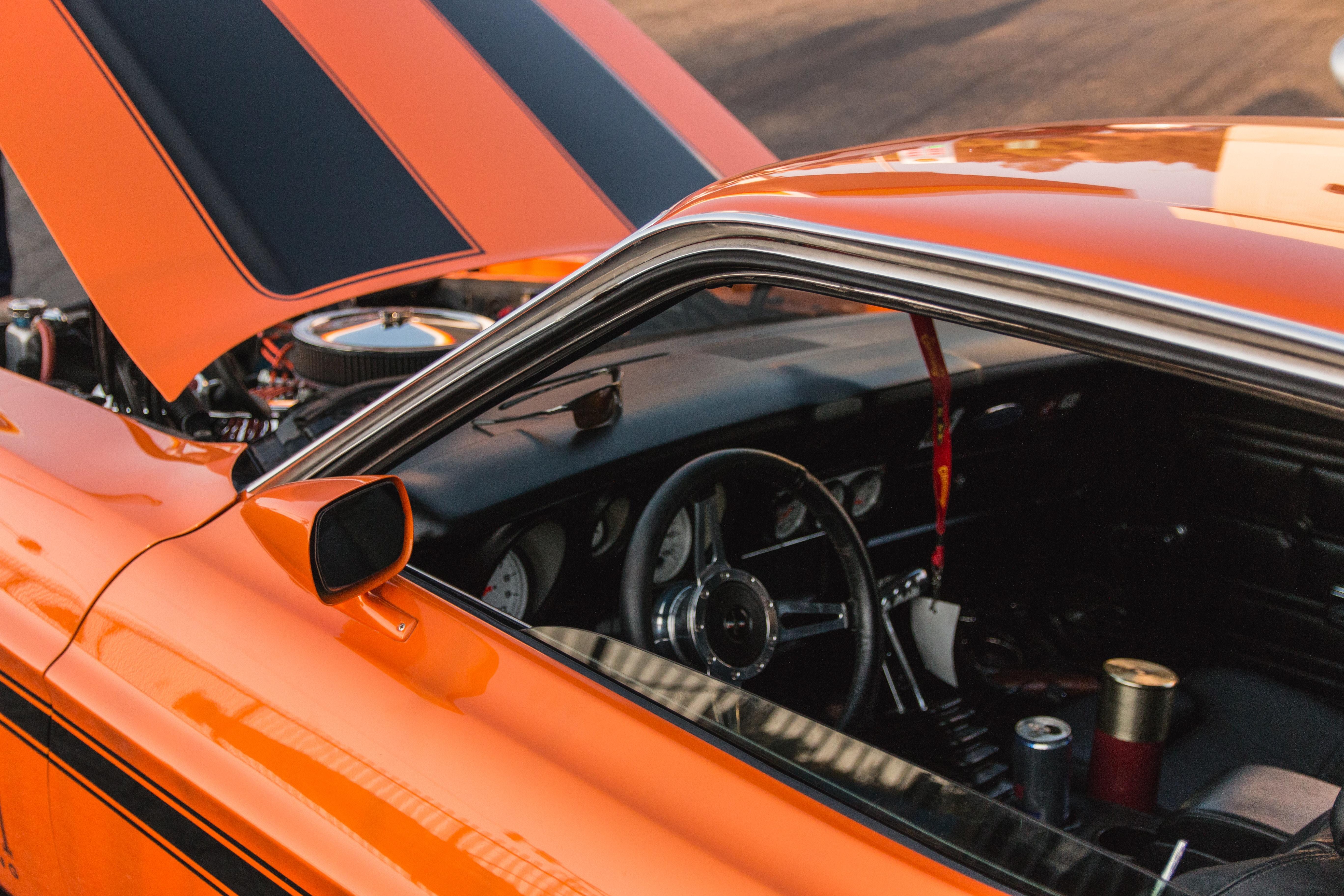 opened orange car engine baty