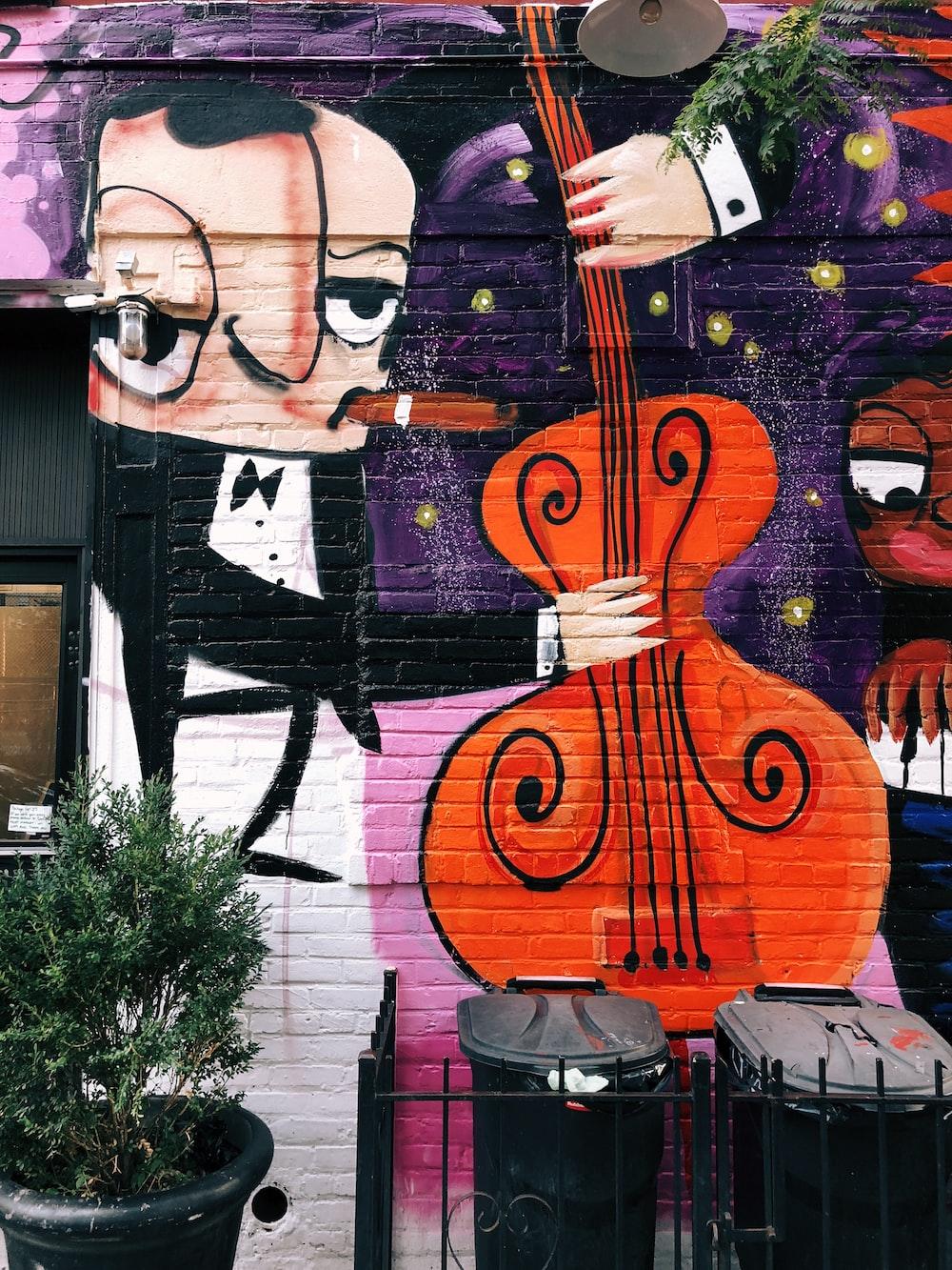 man holding double bass wall art