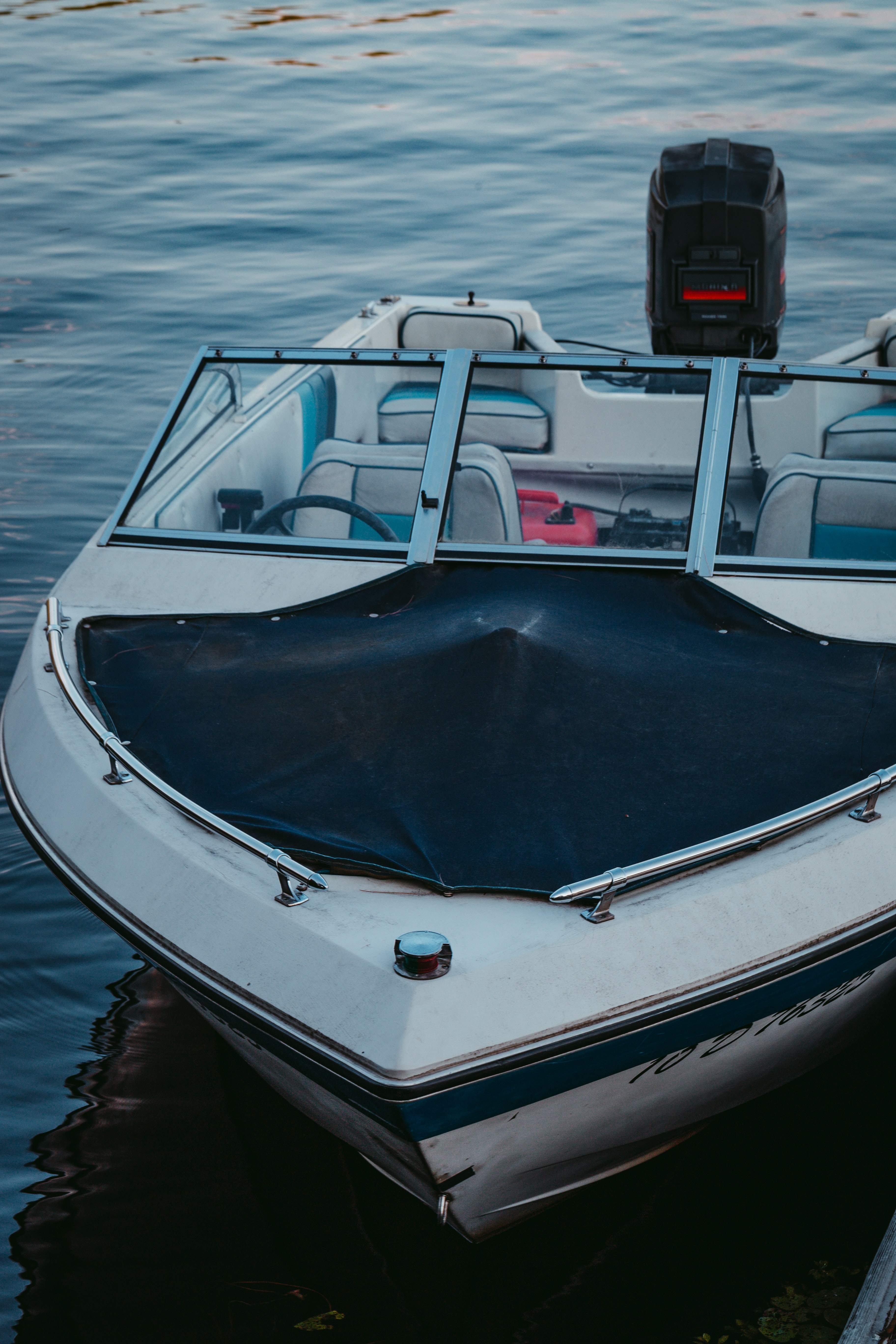 white, black, and gray motorboat during daytime