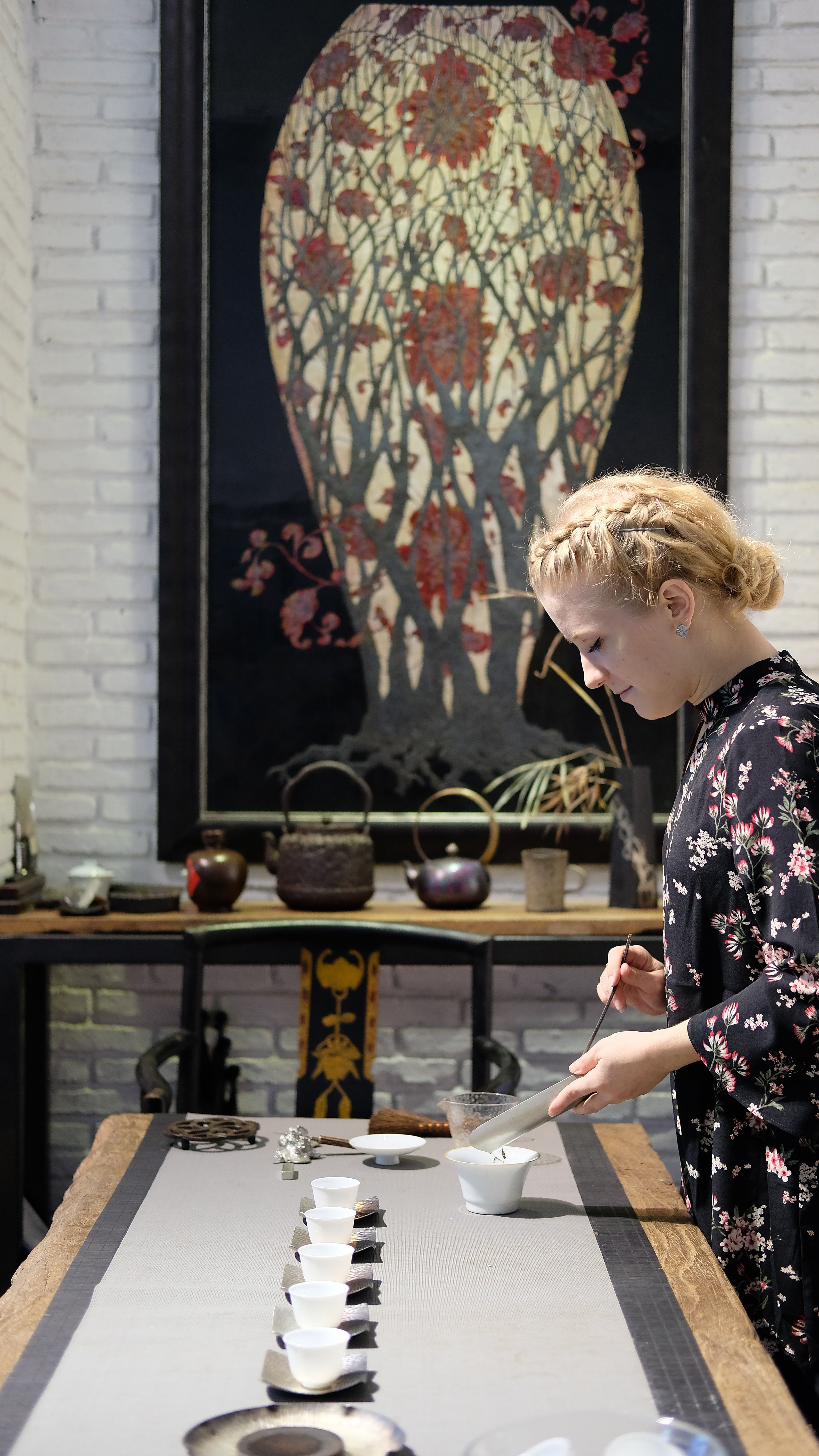 woman pouring into cup in table