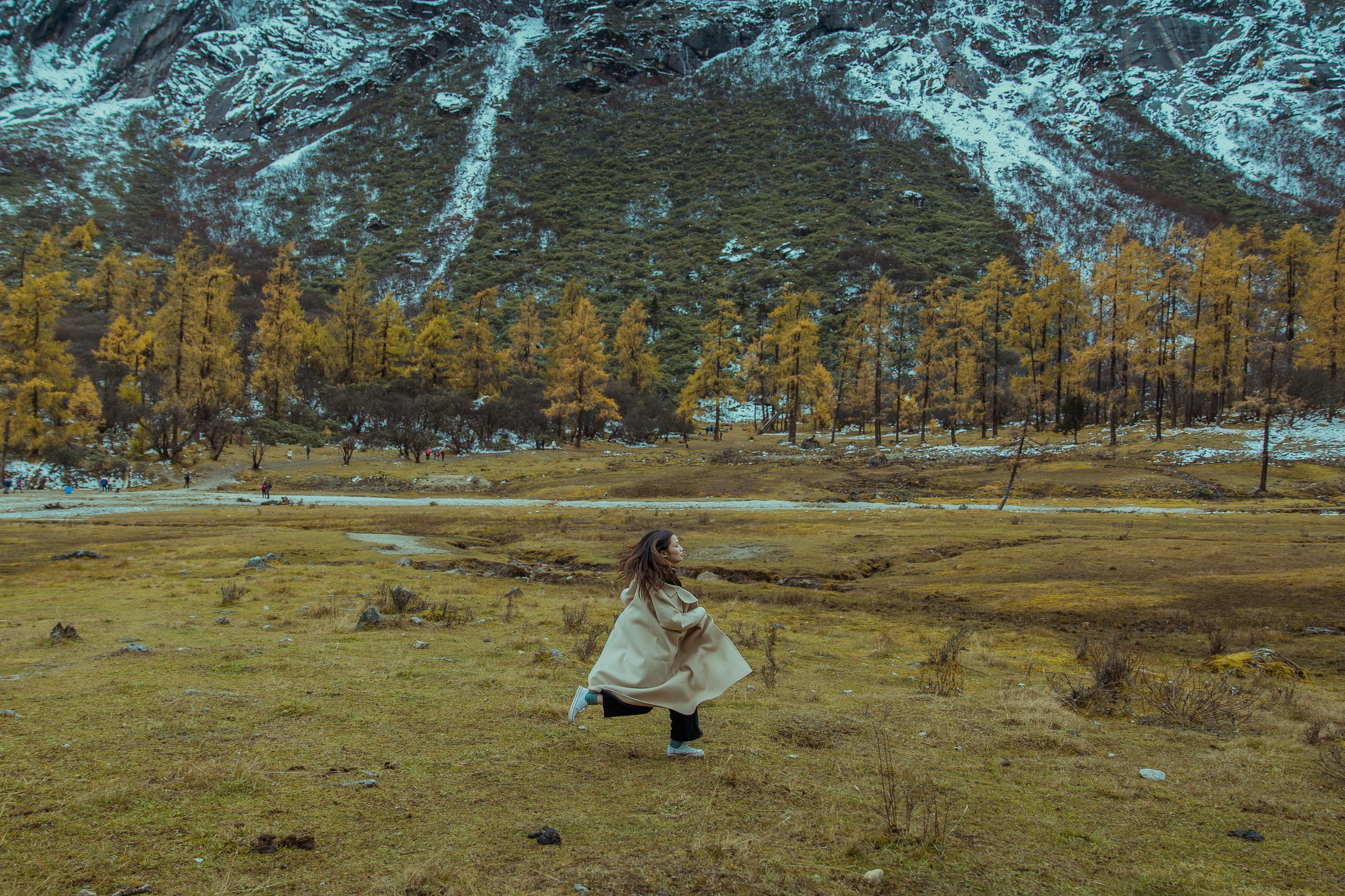 woman running on green grass