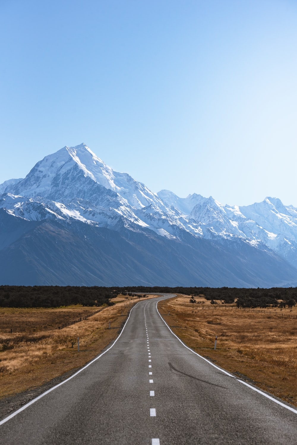 mountains covered with snow near road