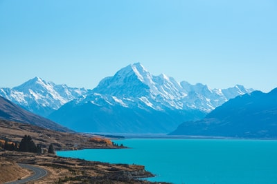 body of water surrounded by mountains new zealand teams background