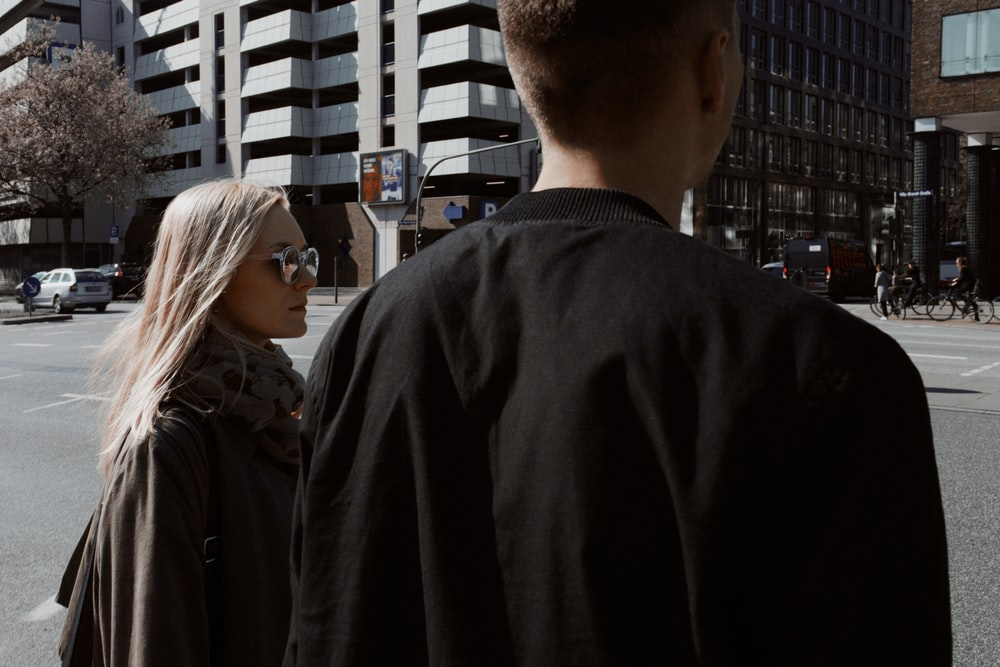 man and woman looking at the street during daytime