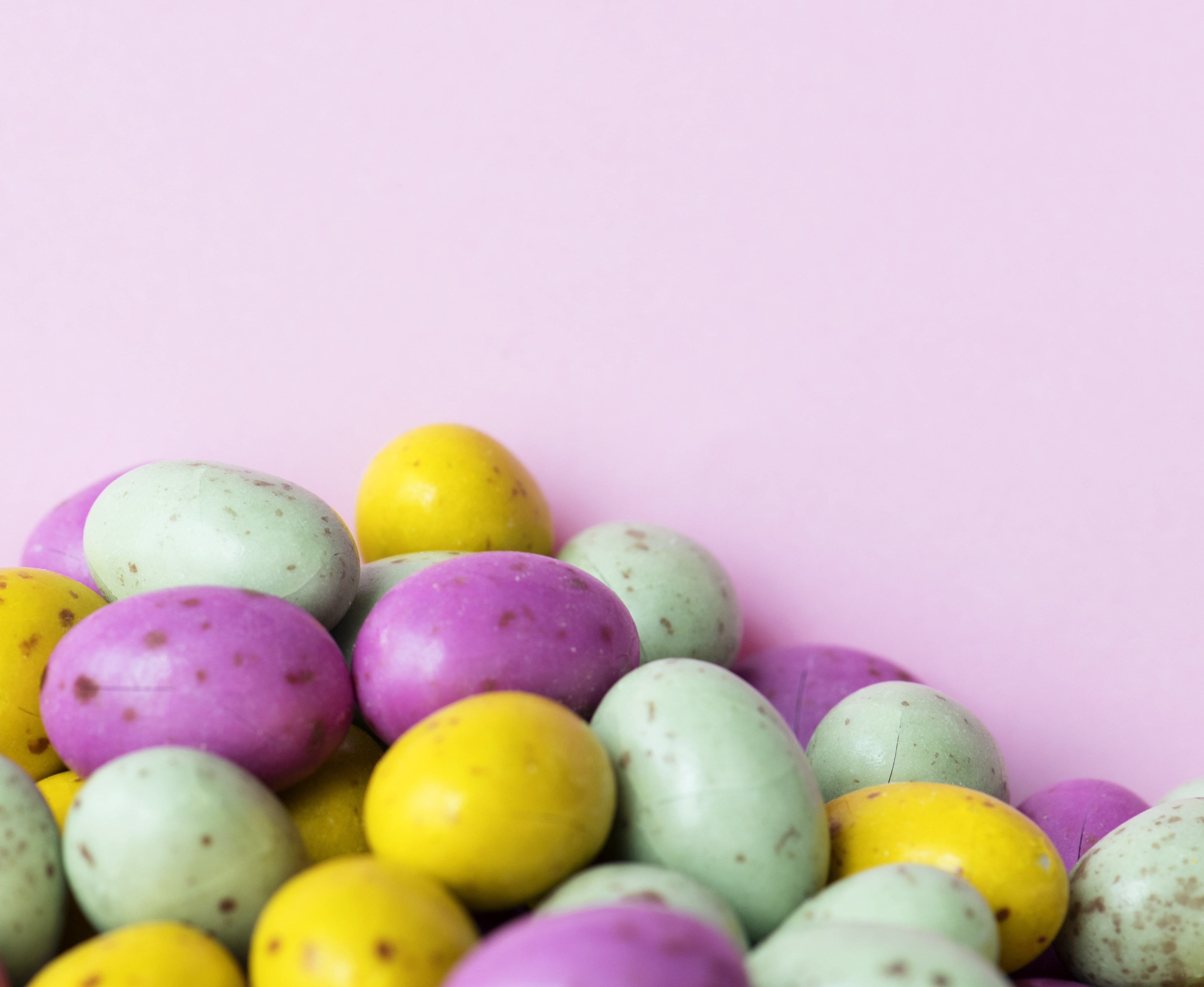 assorted-color egg lot on pink container