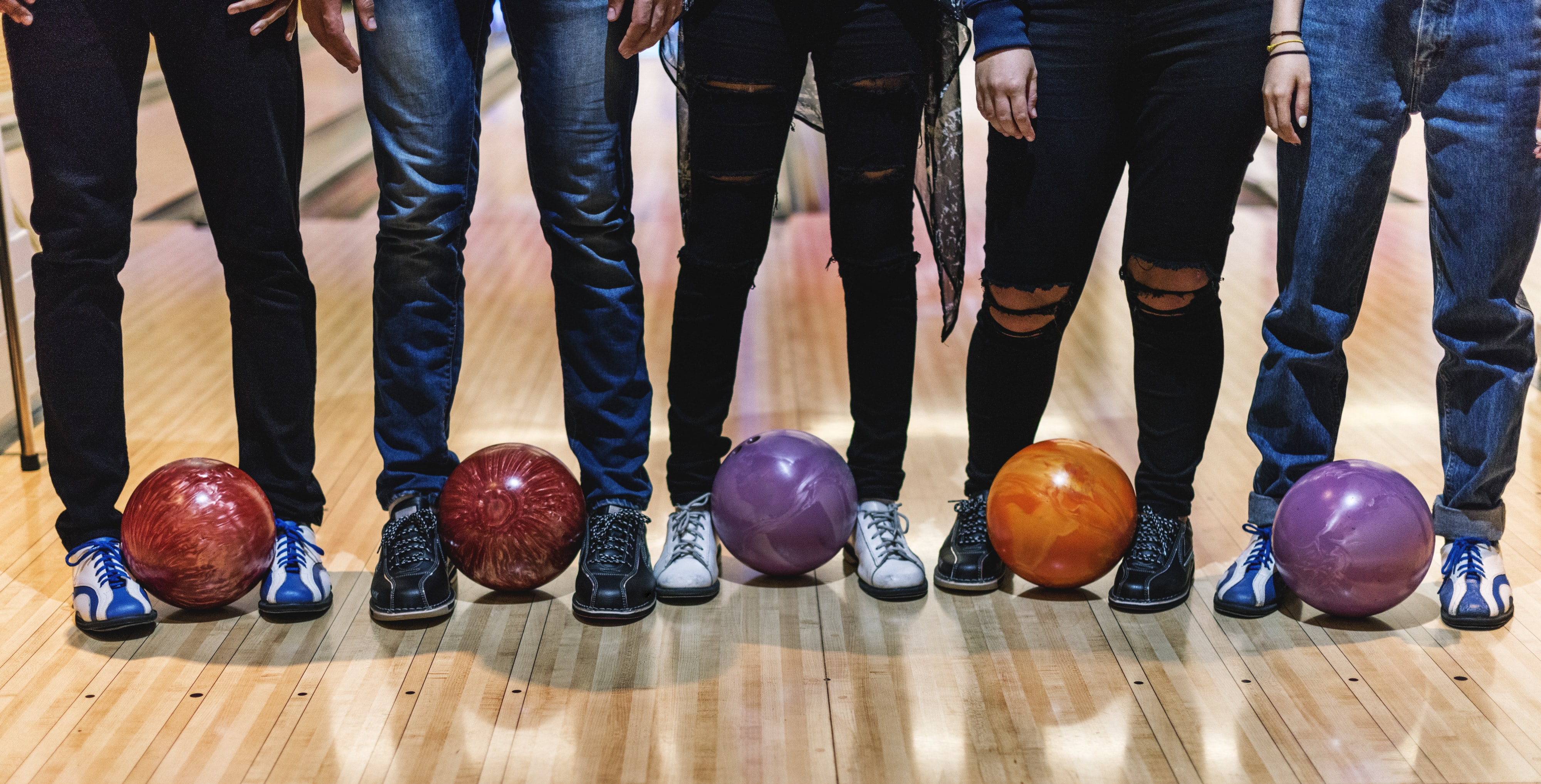 bowling balls on brown floor