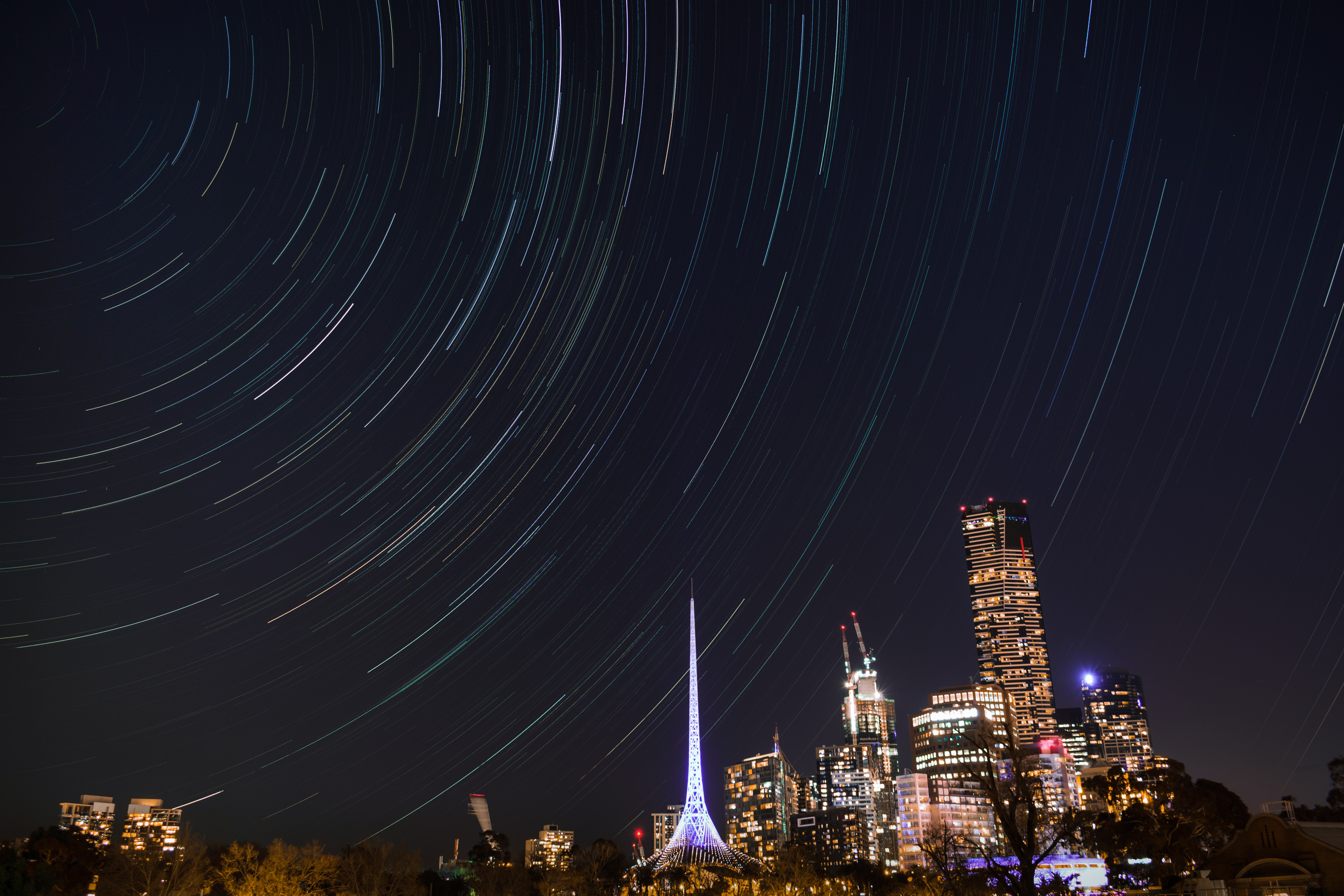 time lapse photography of cityscape under night sky