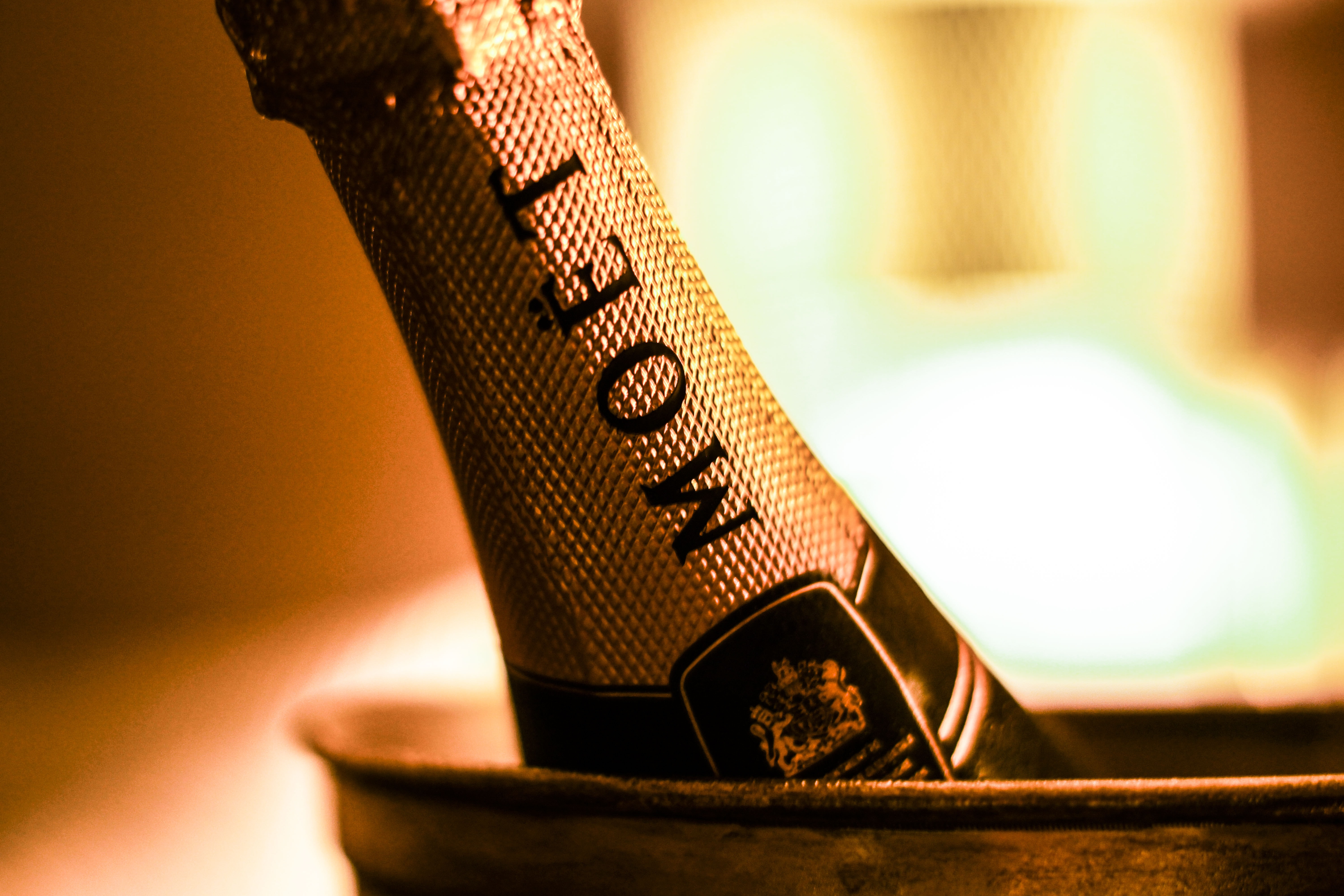 focus photography of Moet bottle inside bucket