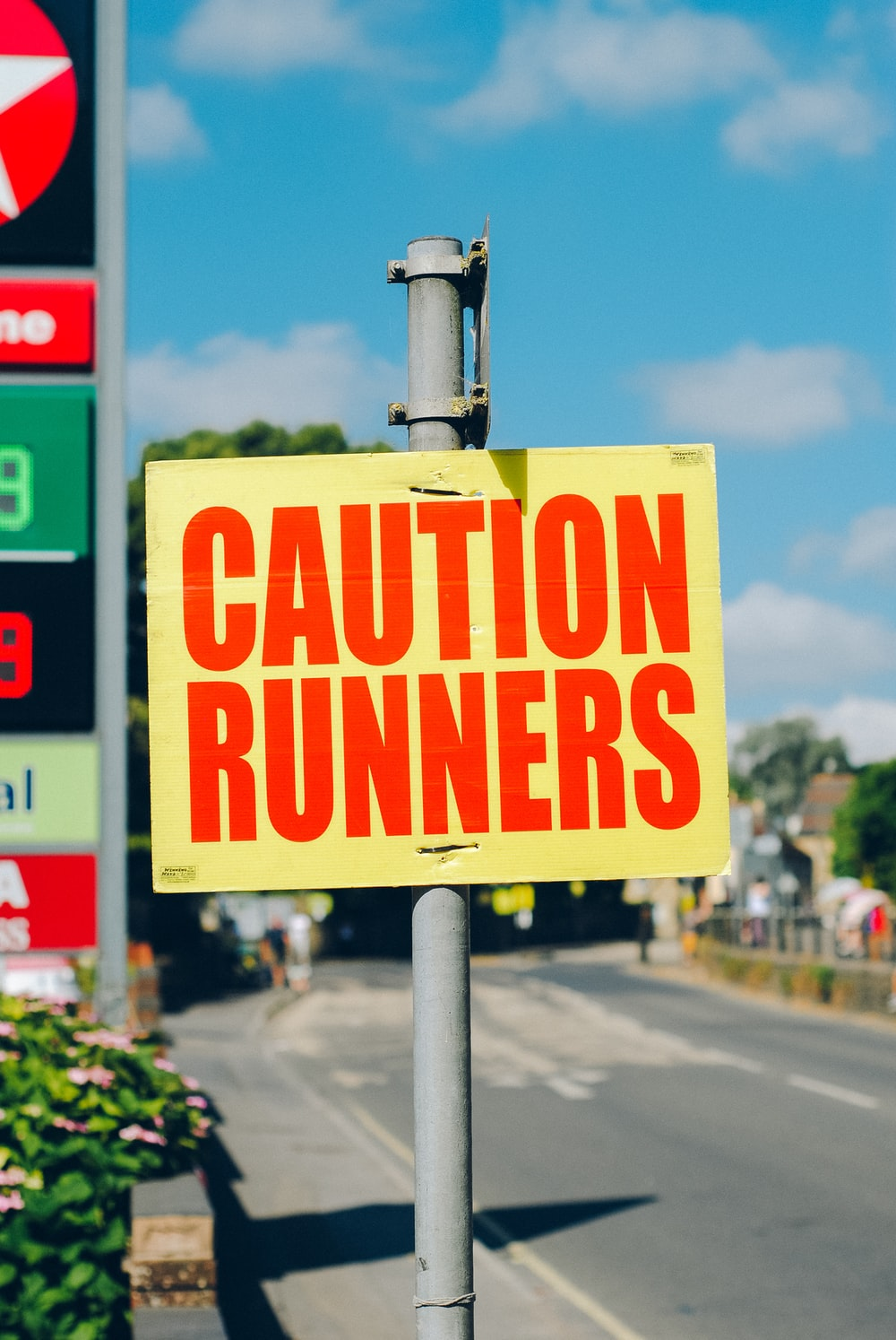 caution runners printed signage on road