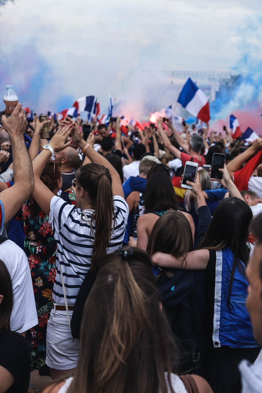 people gathering holding France flags
