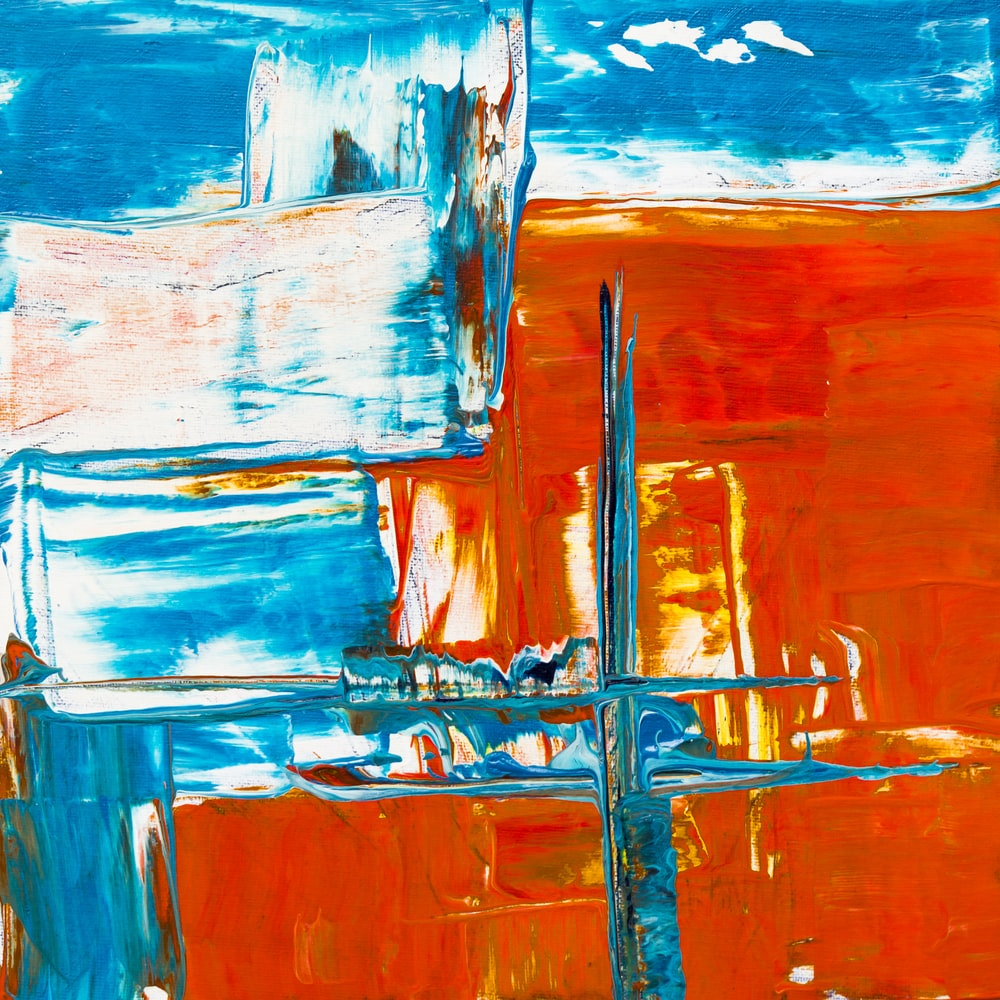 person showing blue and red abstract painting