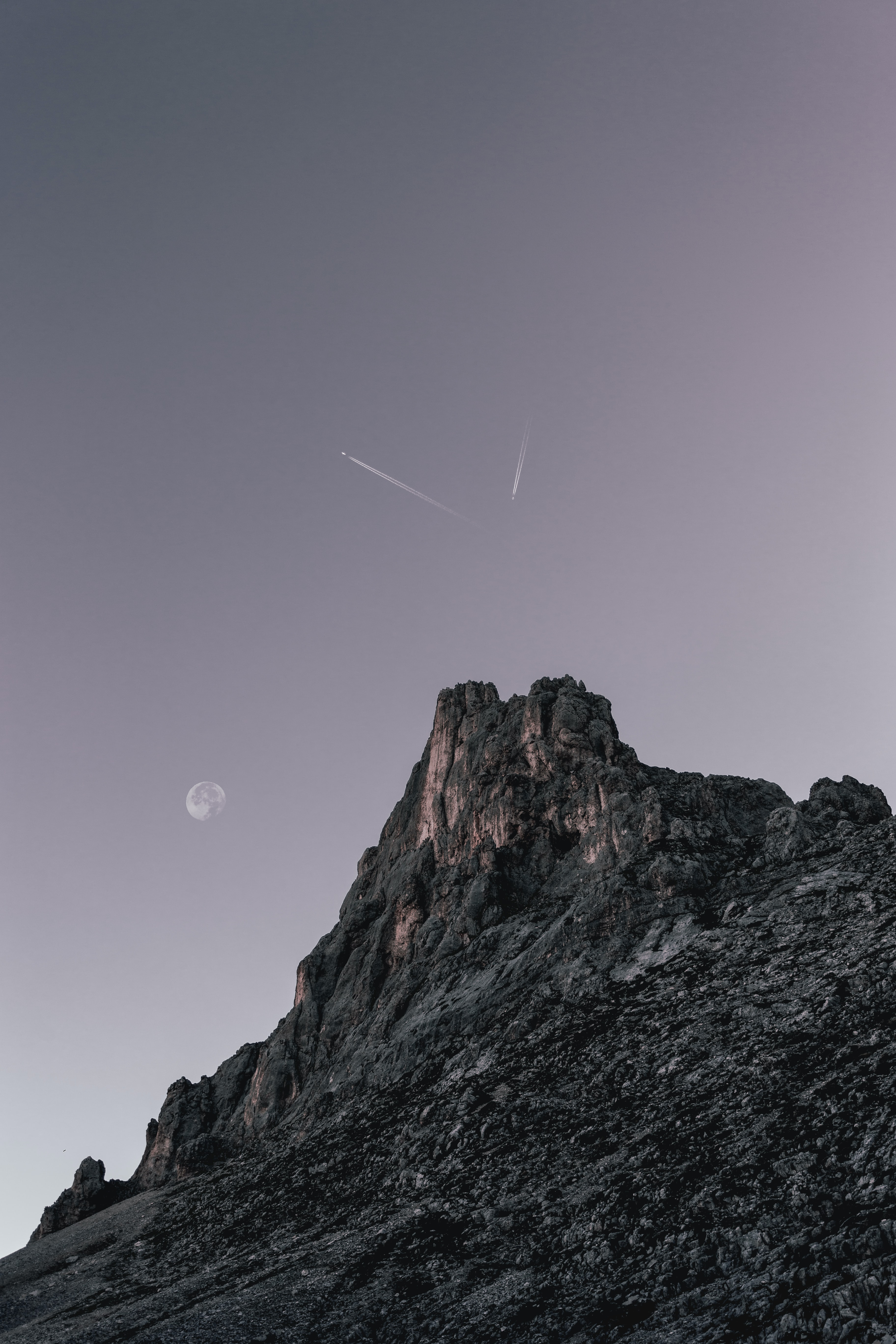 person showing mountain under clear sky