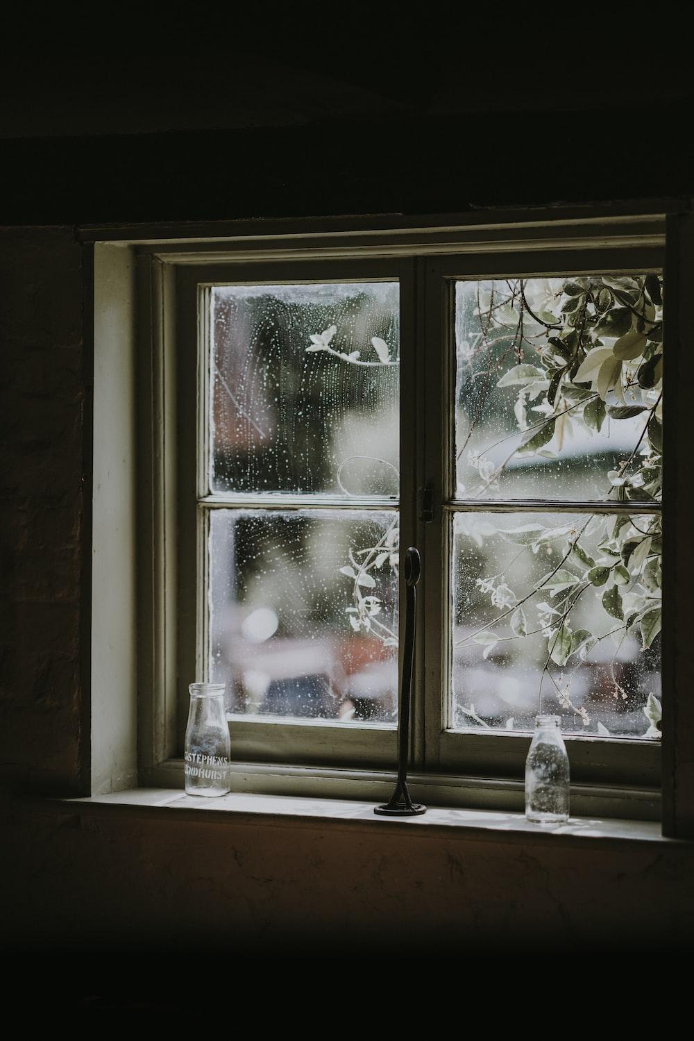 two milk glasses placed near window