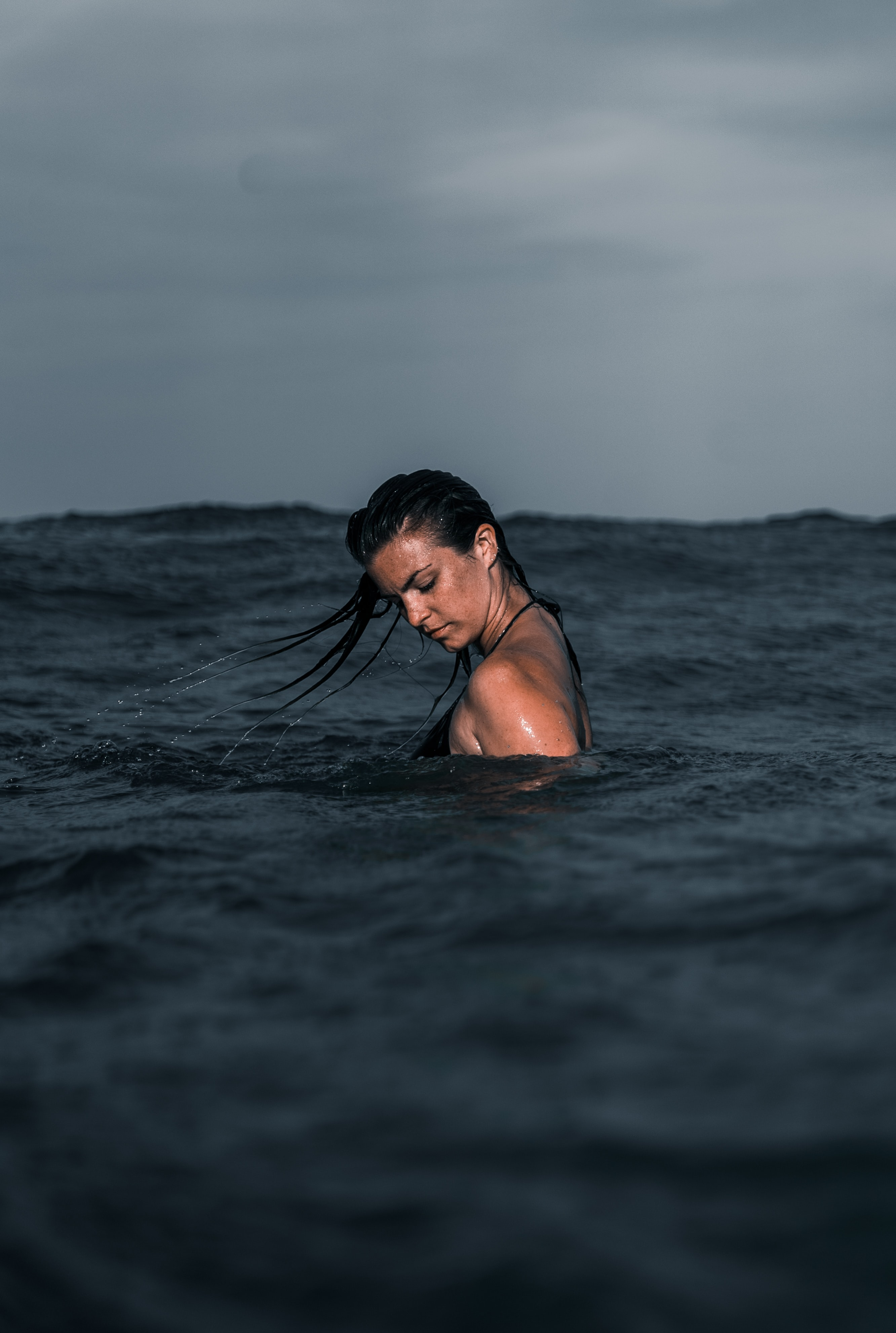 woman in body of water during day