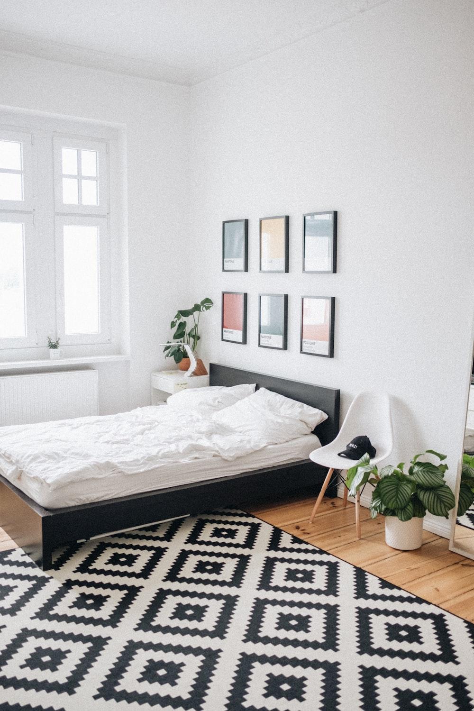 black platform bed with white mattress inside bedroom