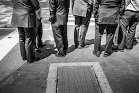 standing men in suit phto