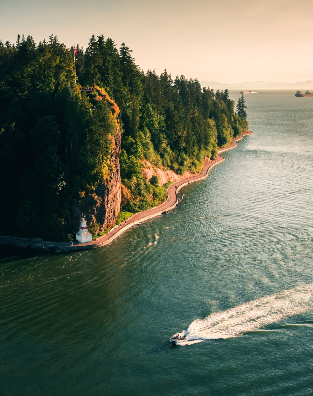 boat on water near cliff