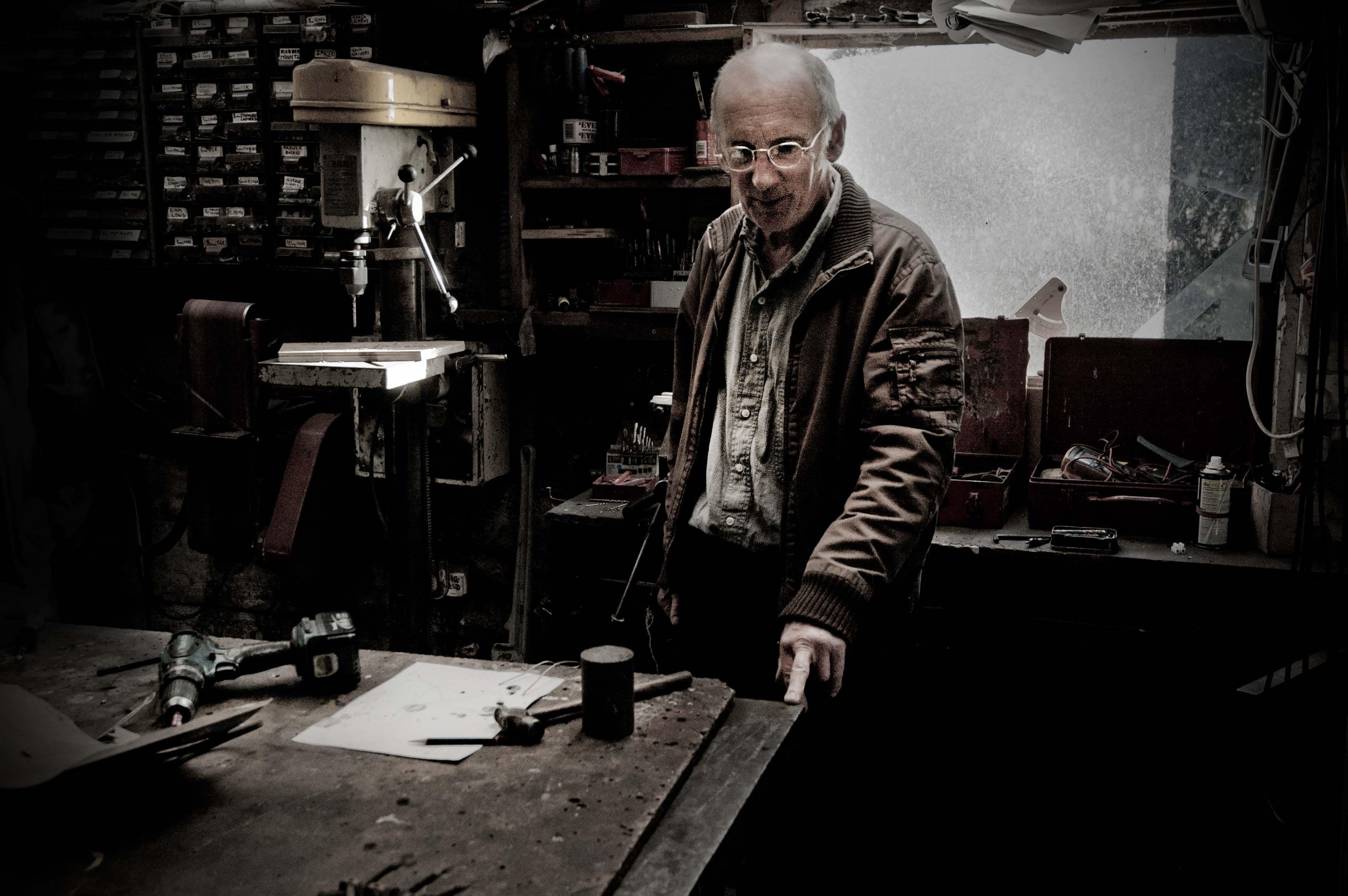 man near drill press
