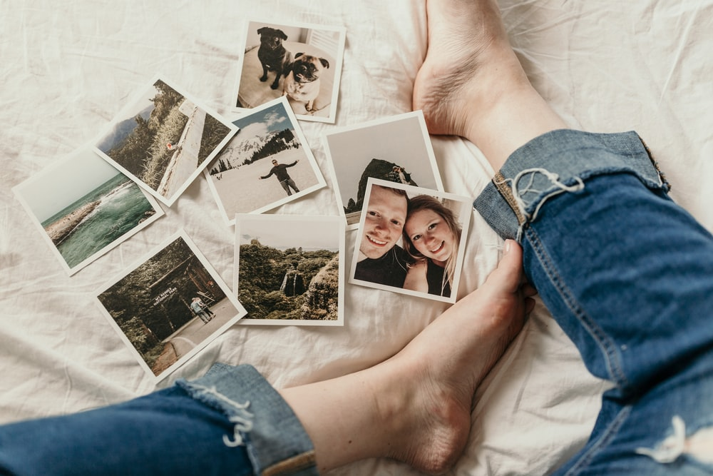 assorted photos on white textile