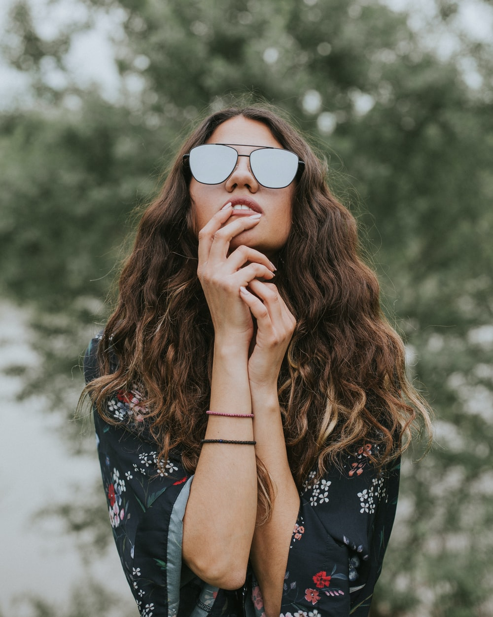 portrait photo of woman wearing sunglasses