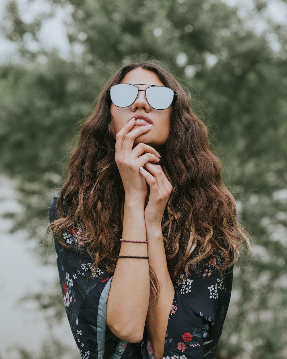portrait photo of woman wearing sunglasses