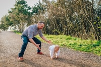 man taking child
