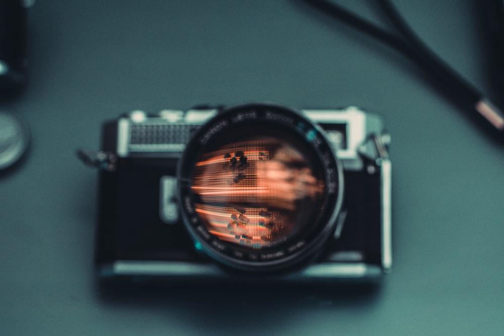 black SLR camera on gray surface