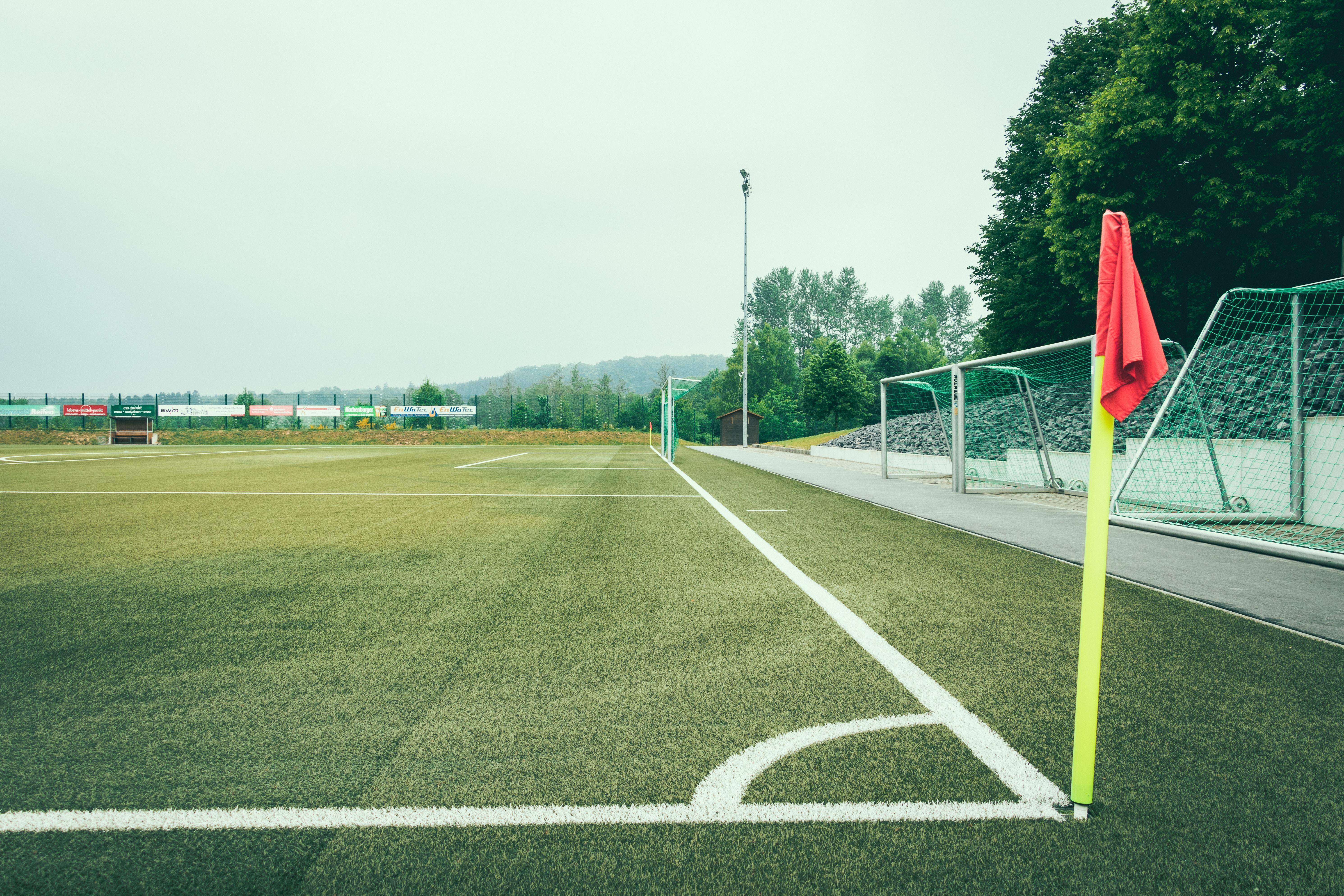minimalist photo of soccer field